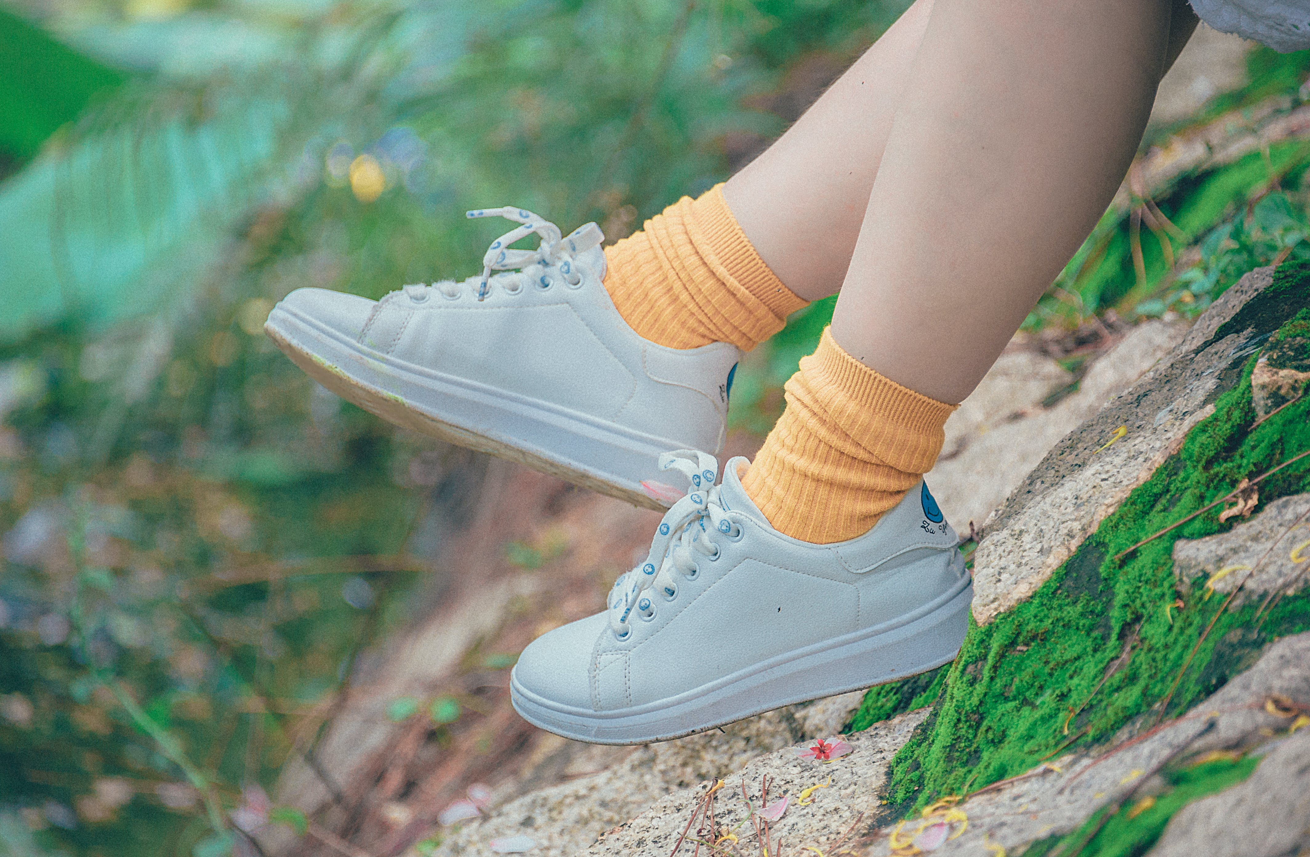 Person Wearing White Plimsoll Shoes