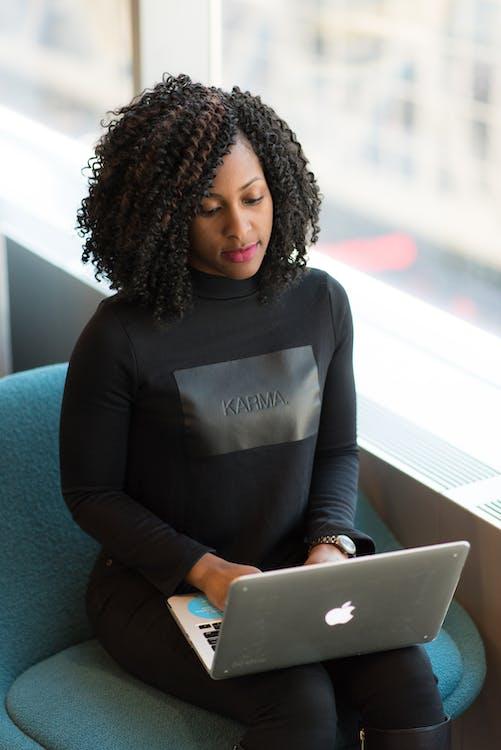 Woman in Black Long-sleeved Shirt Using Laptop