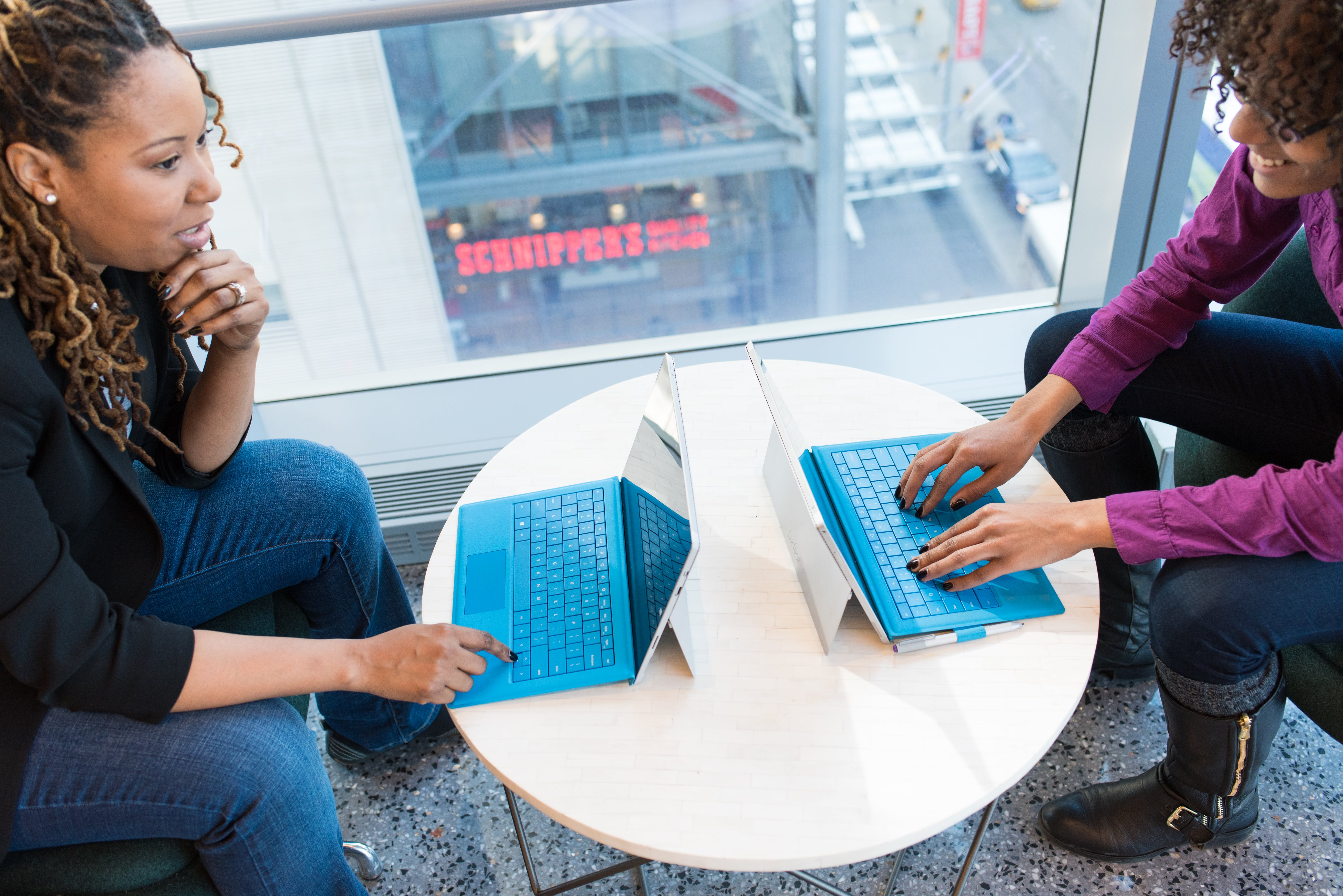 Two Women Browsing On Laptop Computers