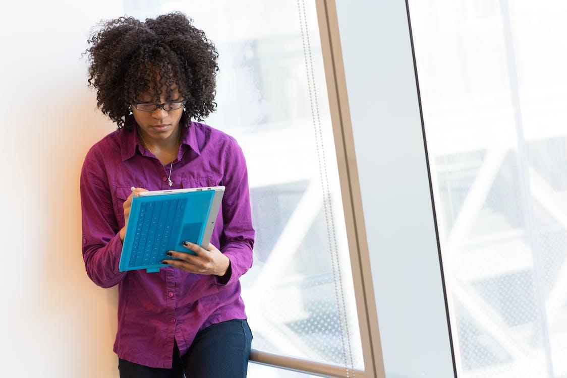 Woman Wearing Purple Long-sleeved Shirt Standing Near Window