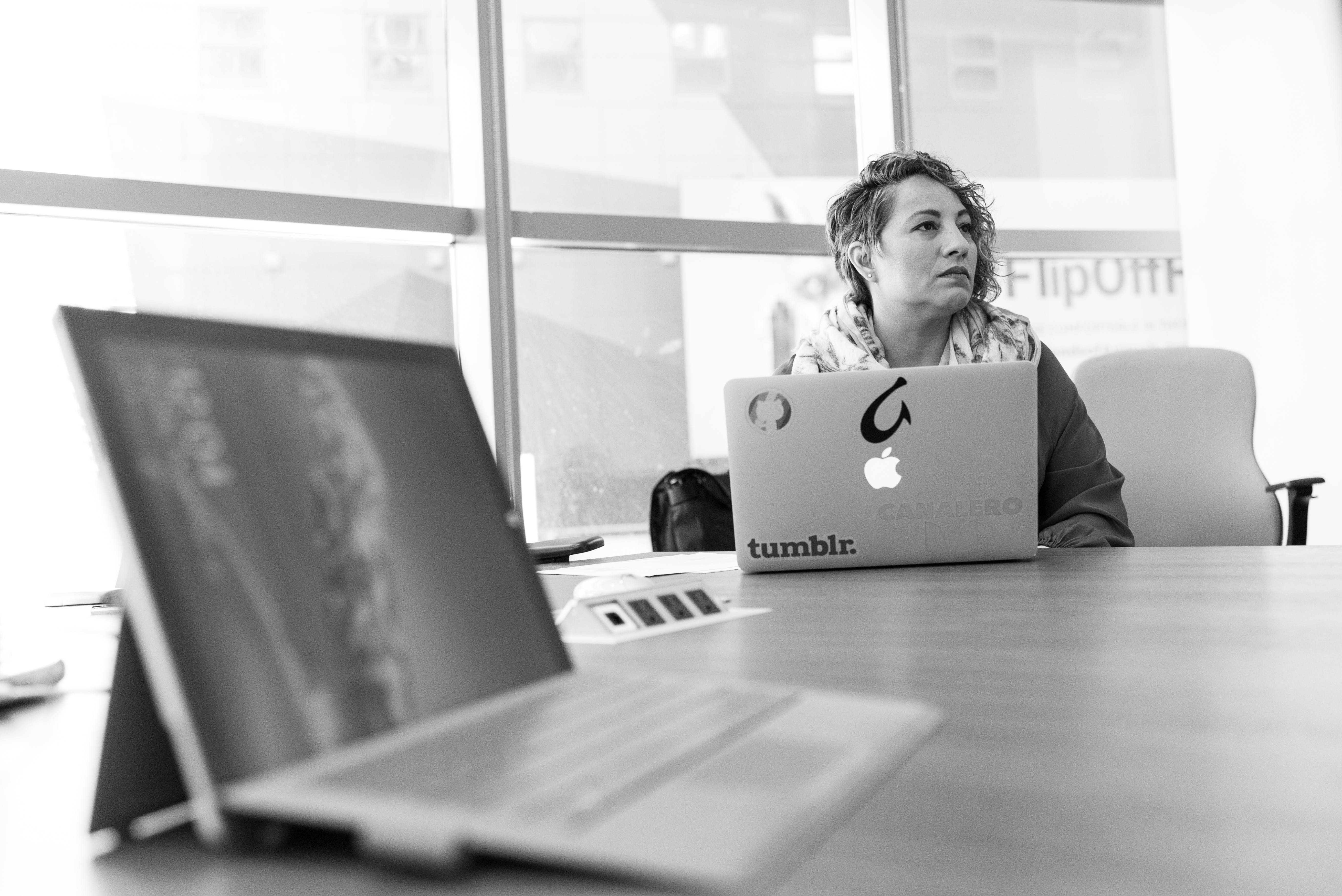 Grayscale Photography of Laptop Computer Near Woman Sitting on Chair