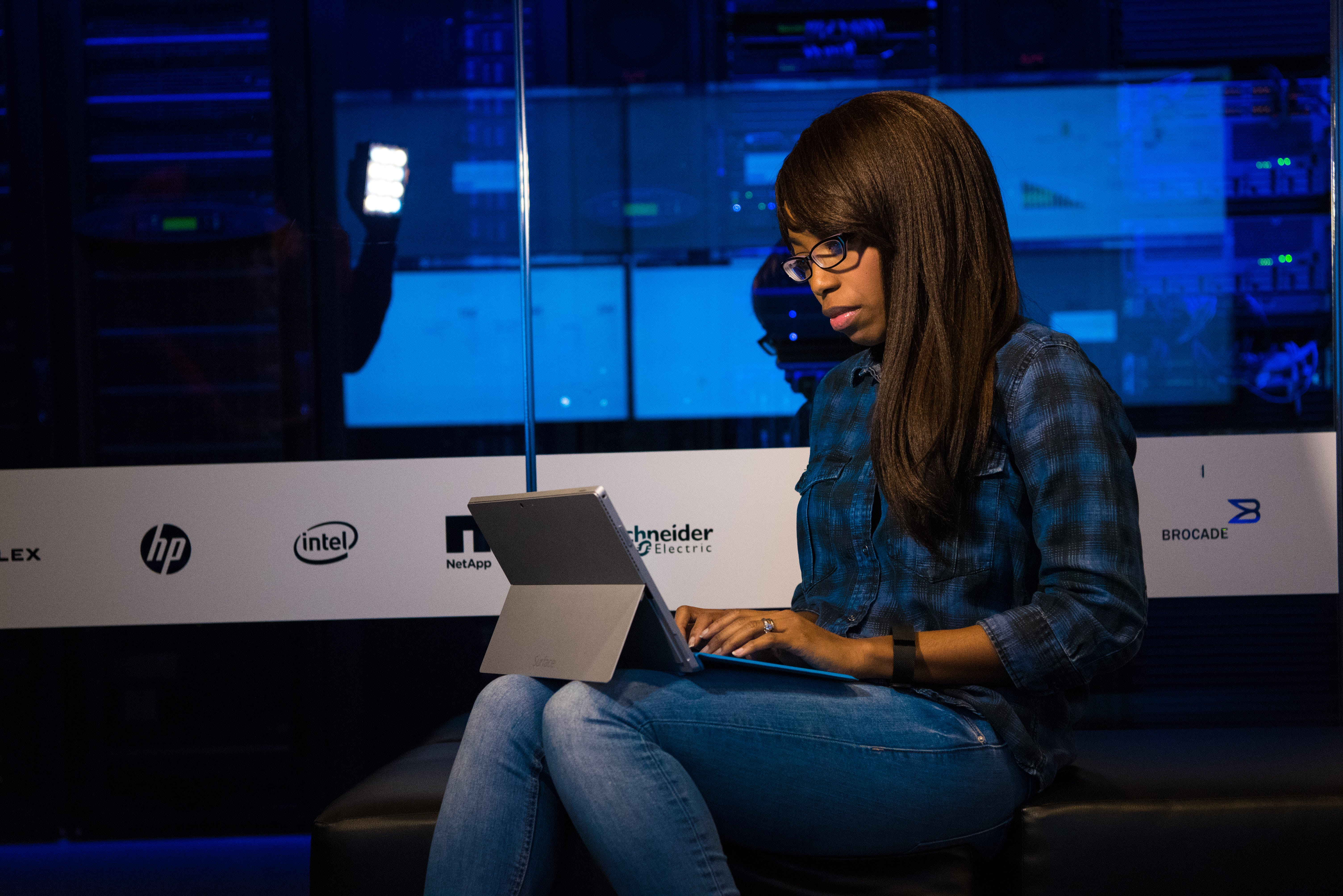 Photo of Woman in Blue Jeans Using Laptop