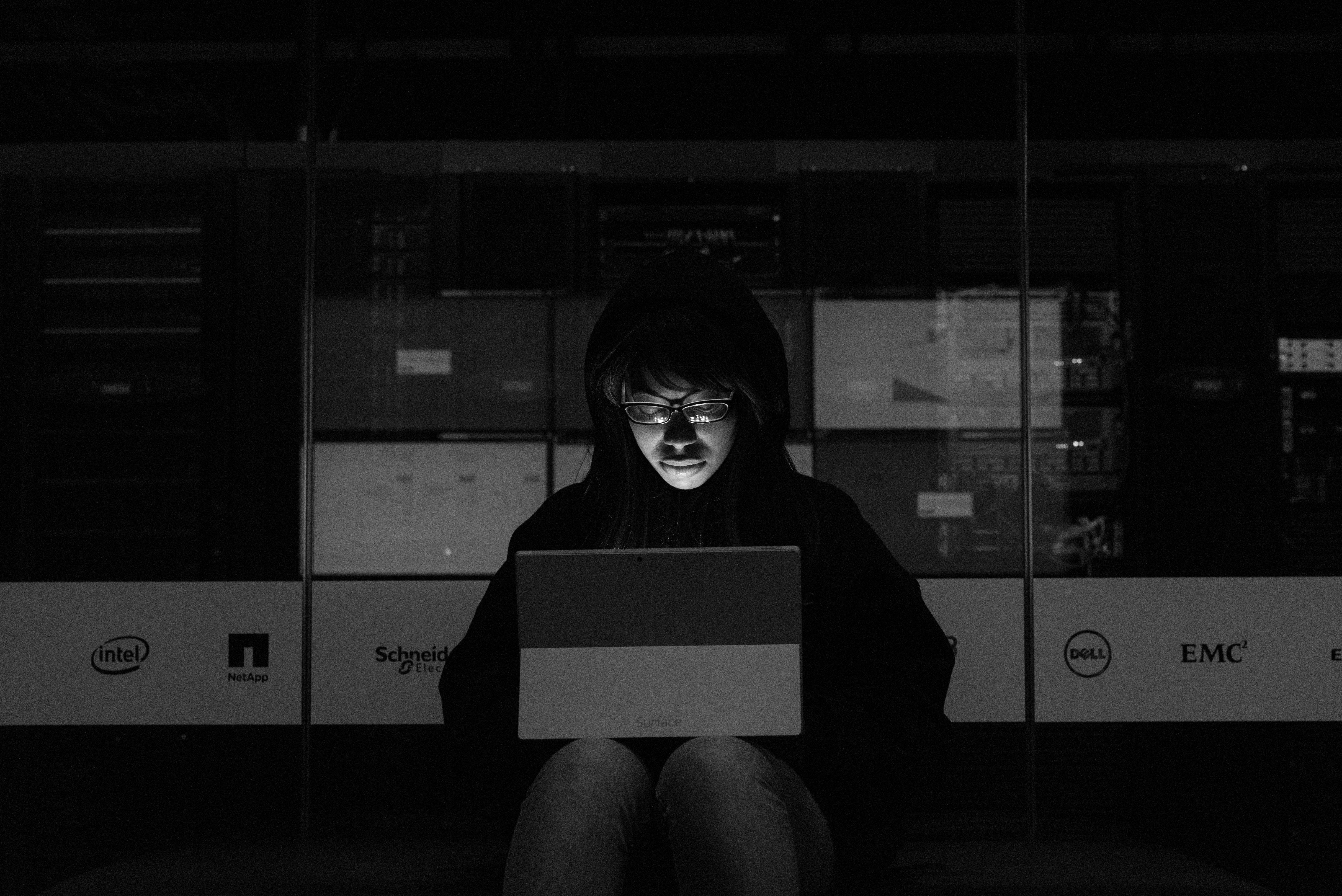 Gray scale Photograph of a Woman using a Laptop