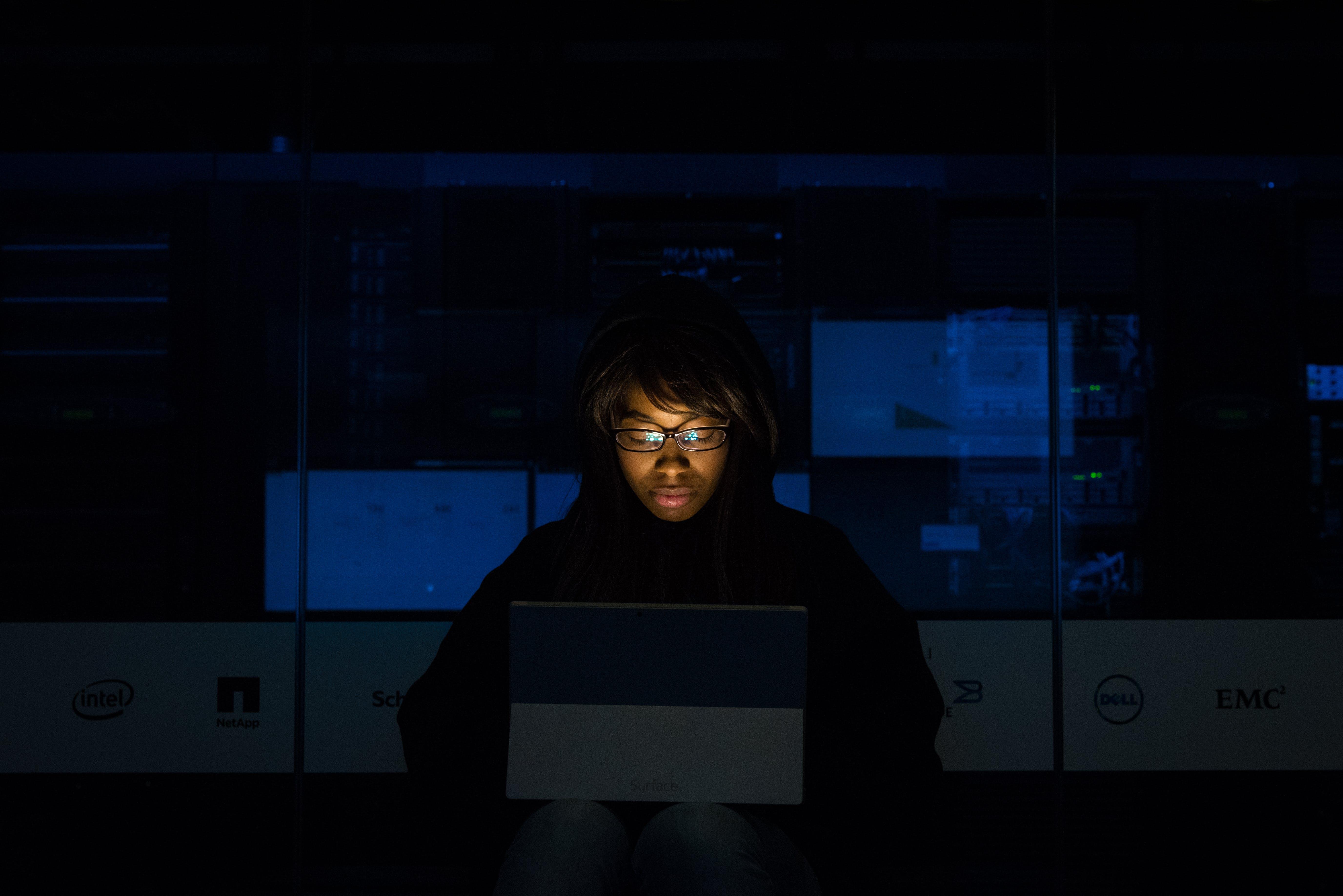 Woman Wearing Black Hoodie Jacket Holding Grey Laptop Computer