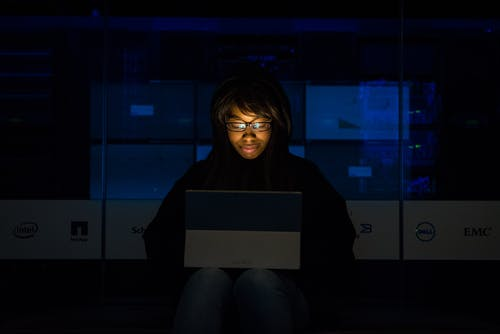 Woman working on her computer.