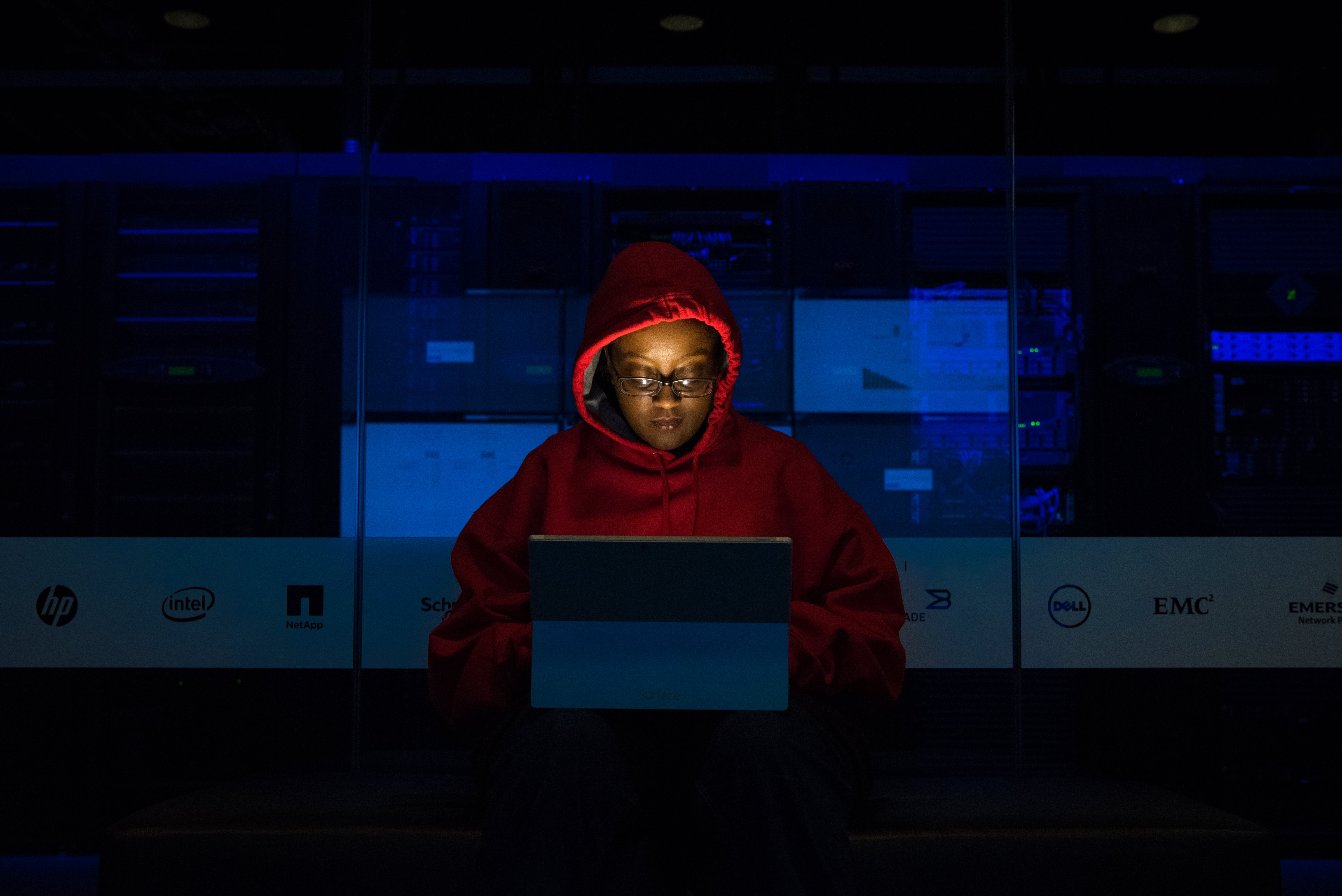Woman Wearing Hooded Pullover Hoodie Facing Tablet Computer