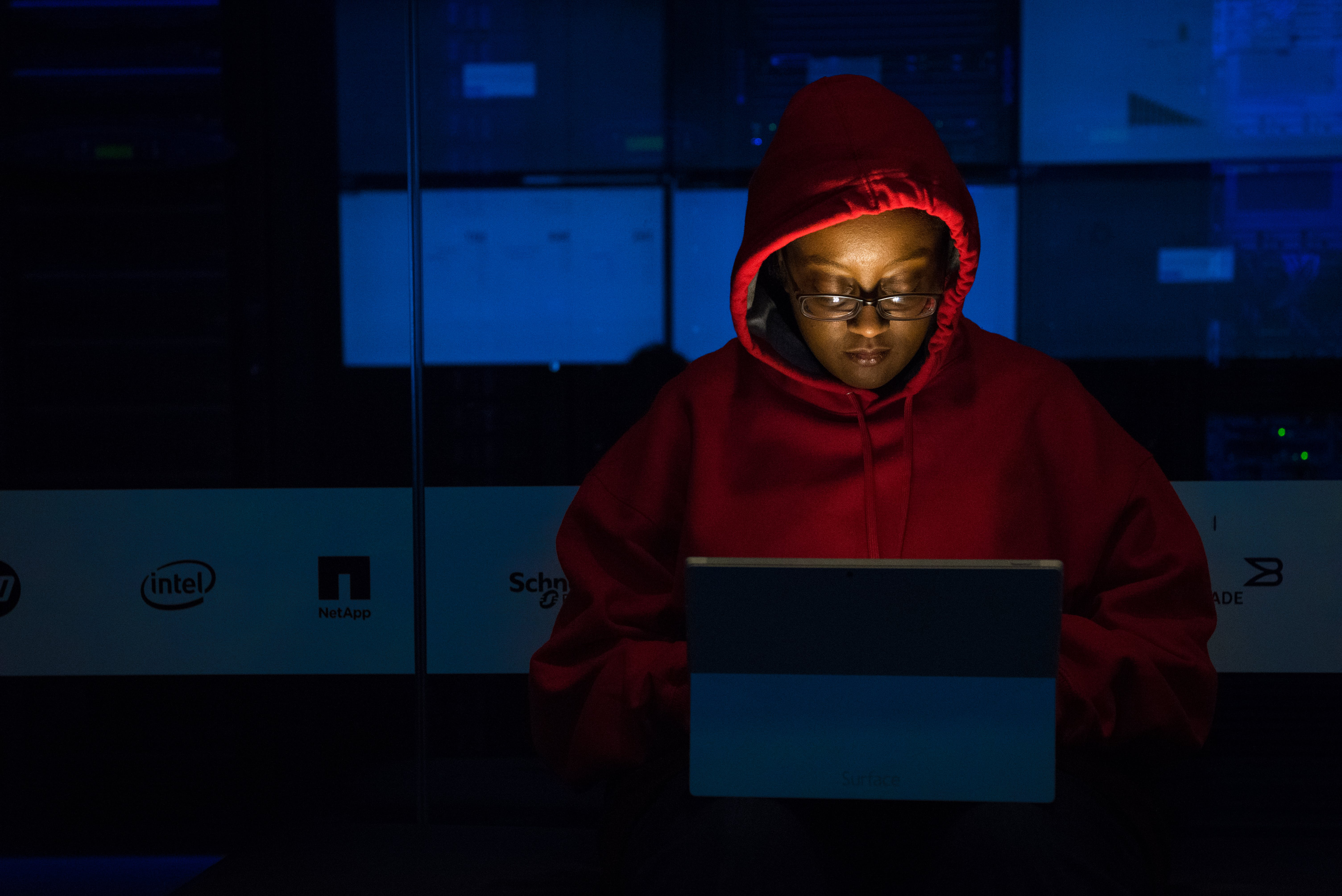 Woman in Red Hoodie Using Gray Laptop Computer