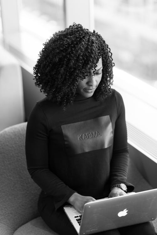 Monochrome Photography of Woman Using Laptop