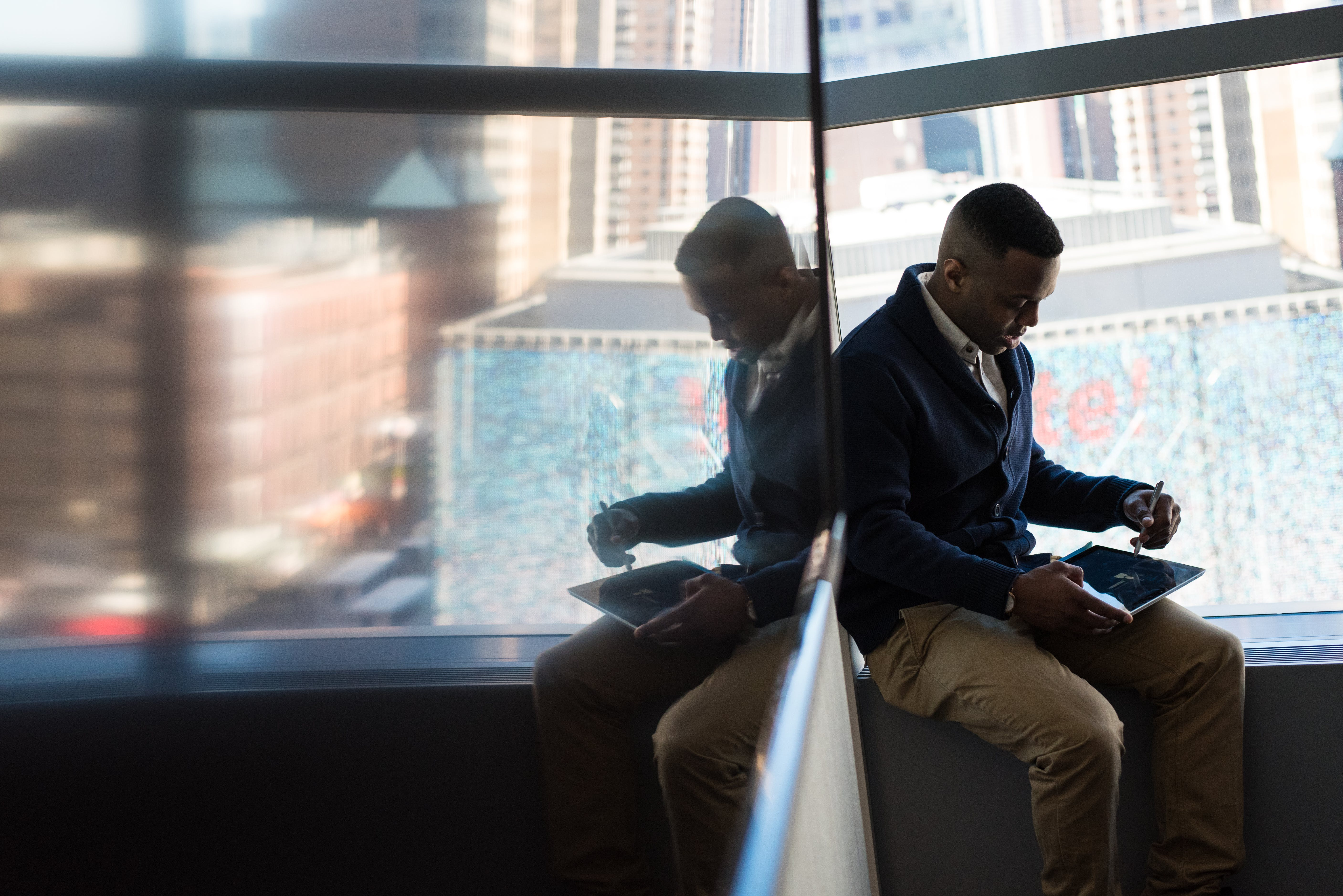 Man Sitting Beside Window
