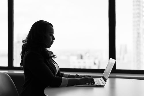 Grayscale Photography of Woman Using Laptop