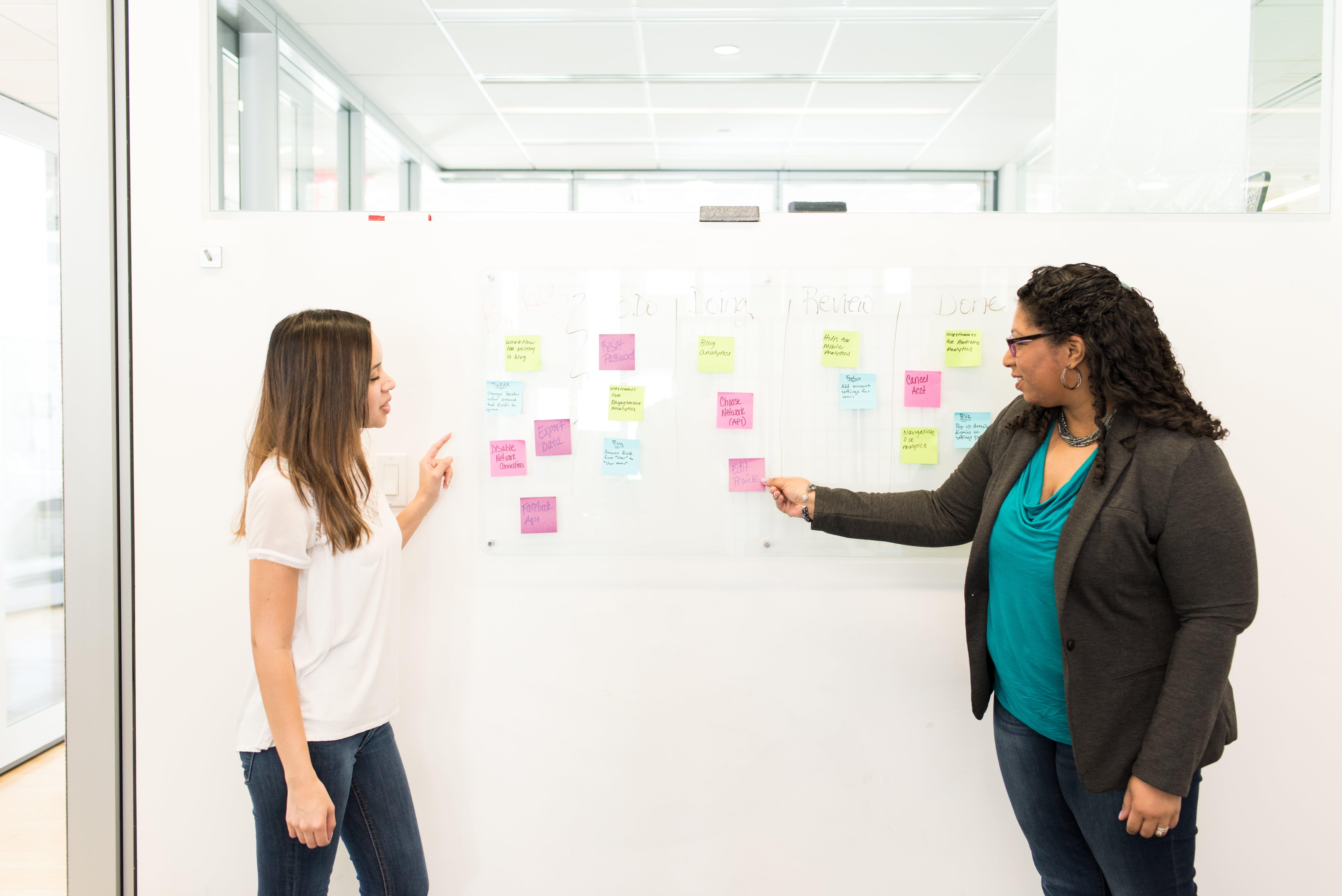 Two Woman Having Conversation