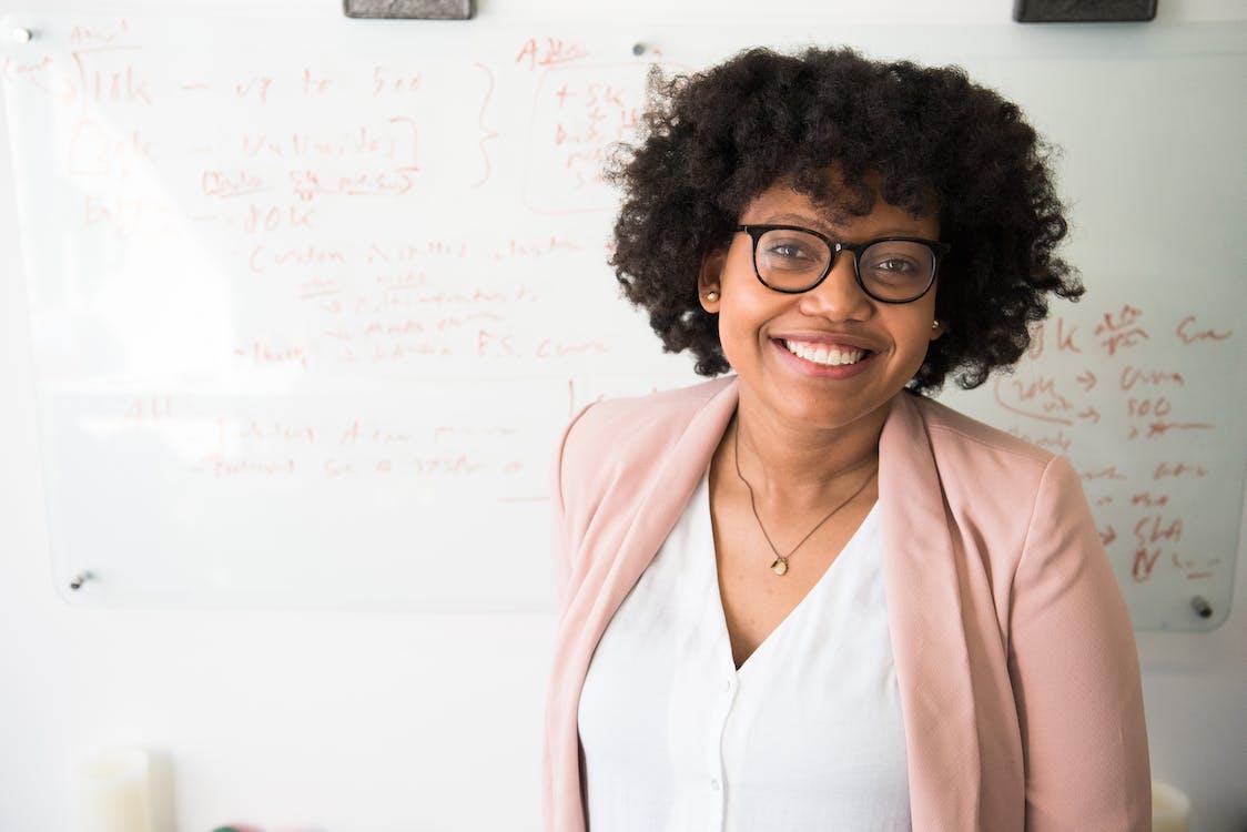 Woman smiling Standing Near Whiteboard