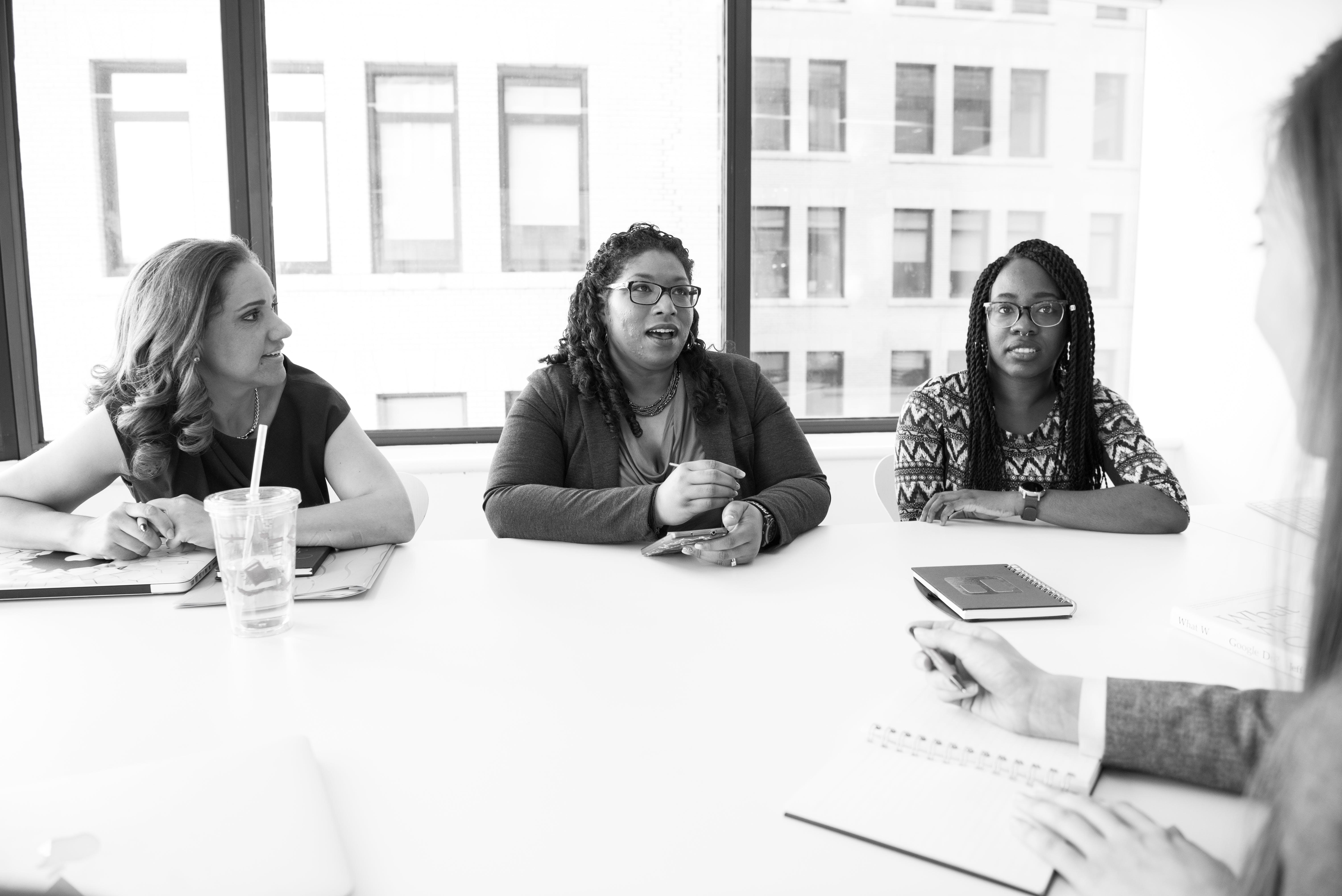 Four Women Sitting Near Table