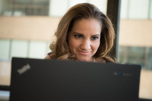 Woman Using Black Laptop
