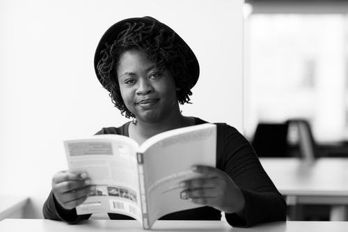 Monochrome Photography of Woman Reading Book