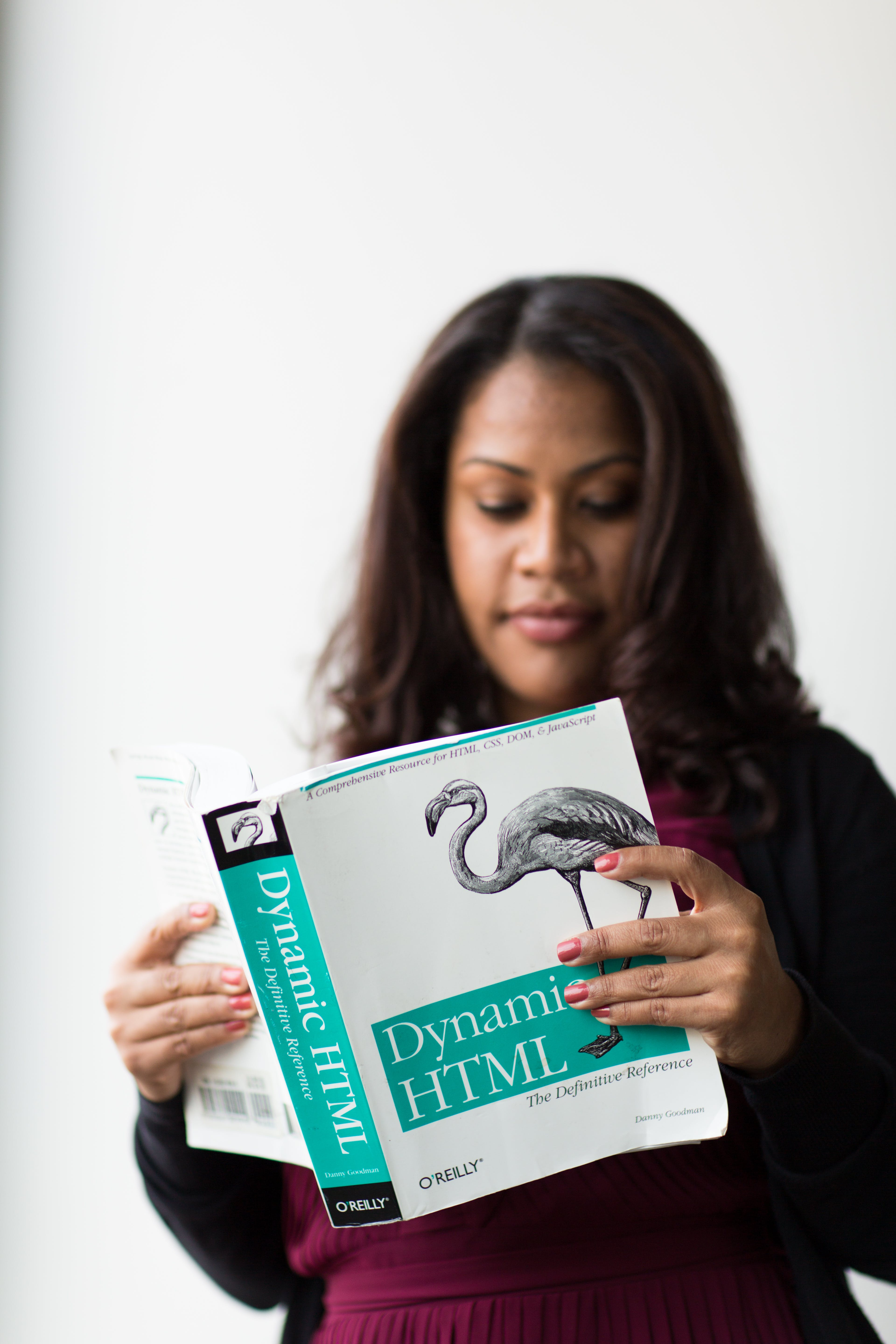 Woman Holding Dynamic Html Book
