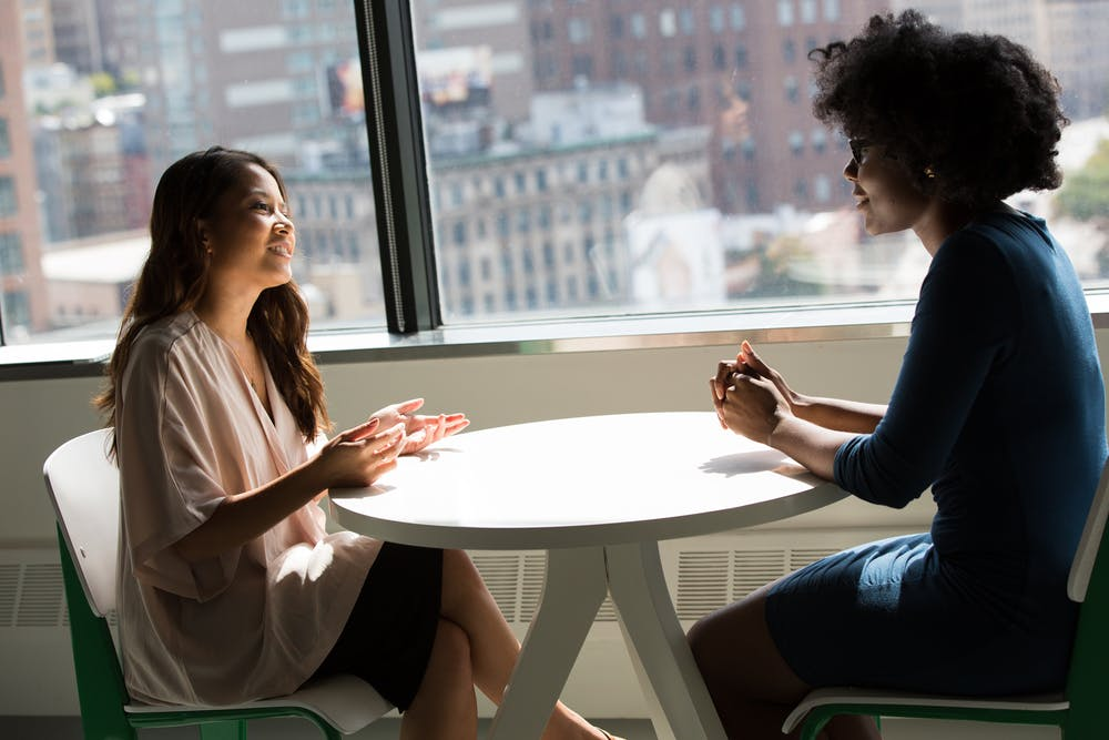 Women talking to each other | Photo: Pexels