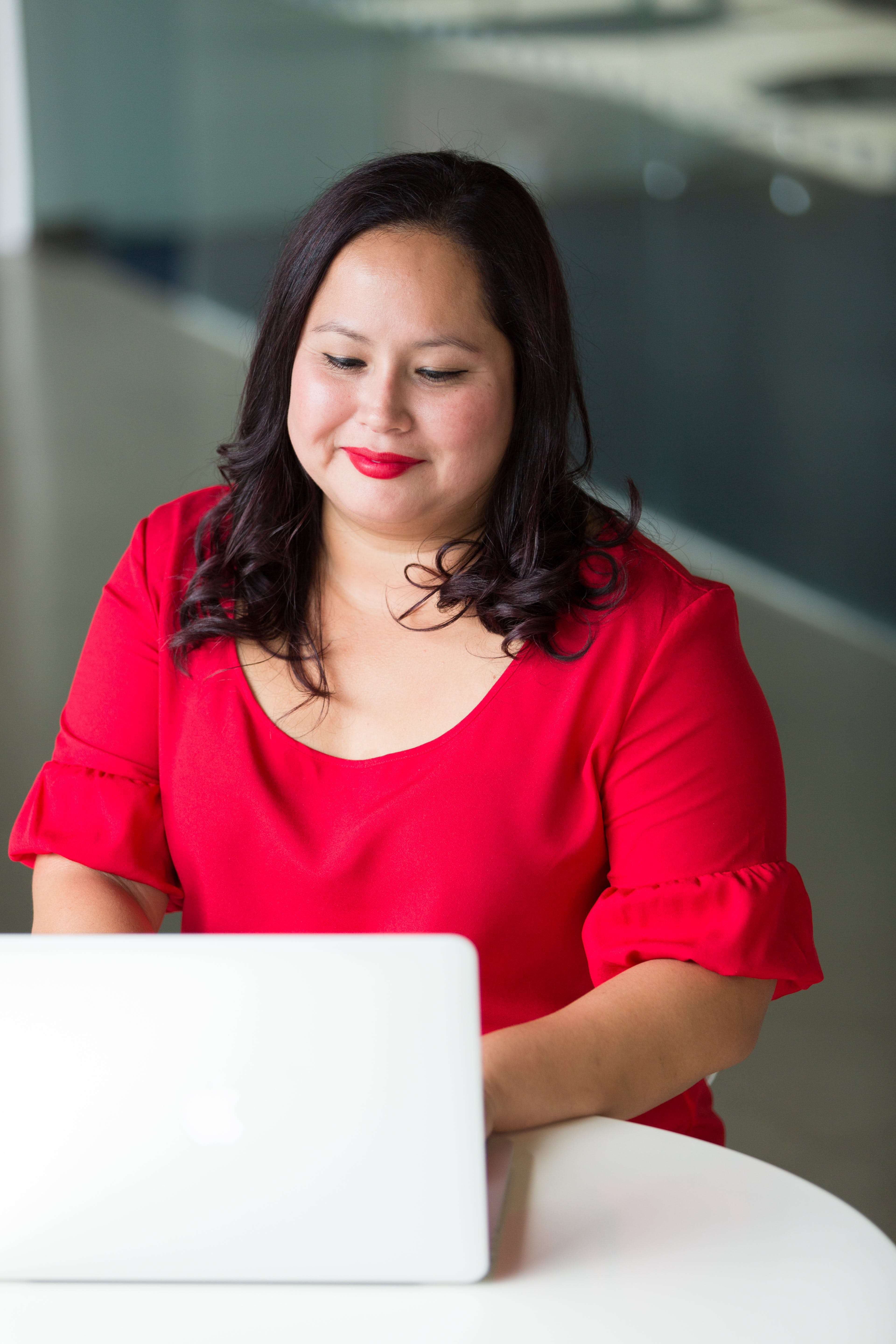 Photography of Woman Using Laptop