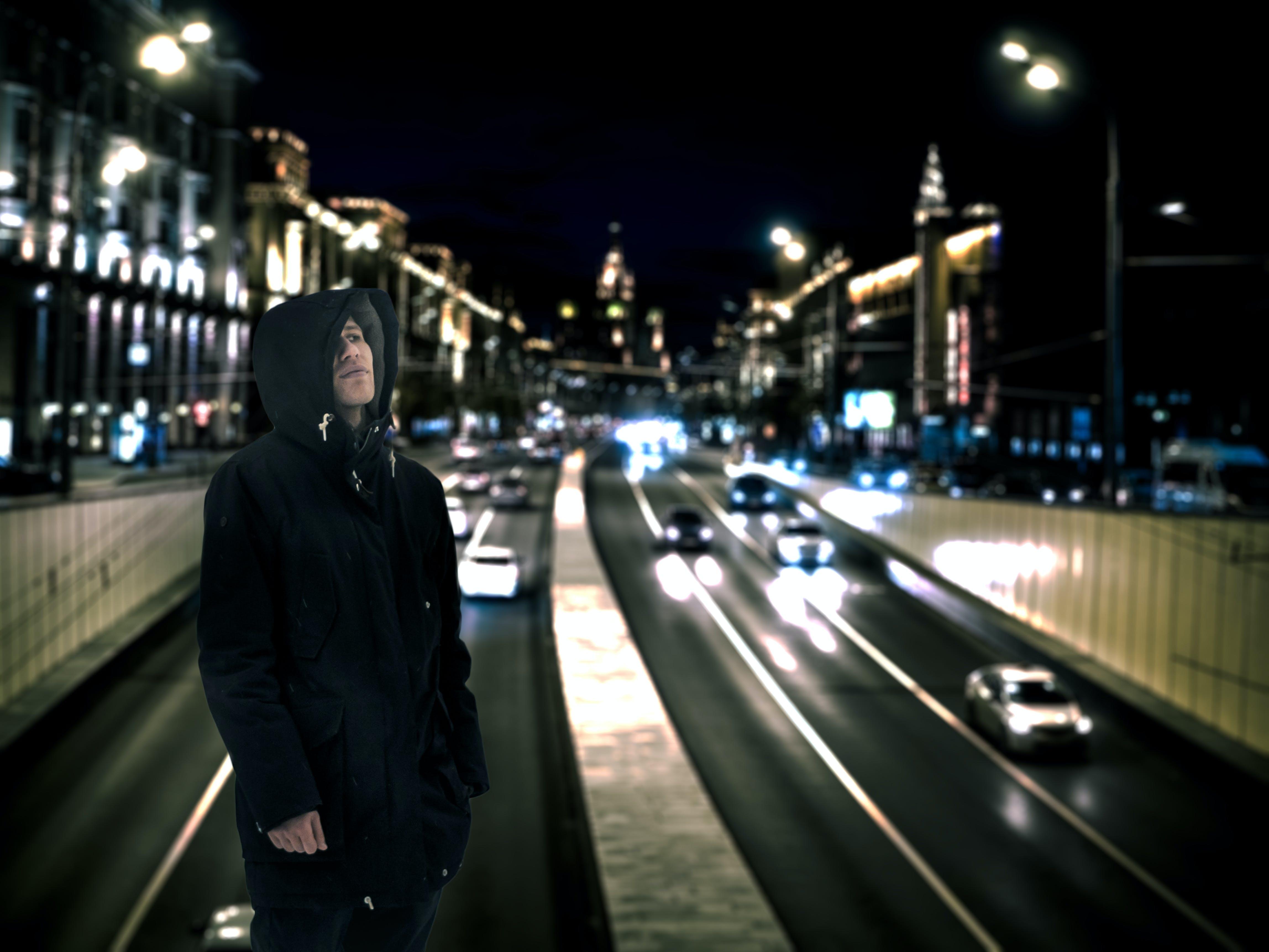 Man Wearing Black Hoodie With Road Background