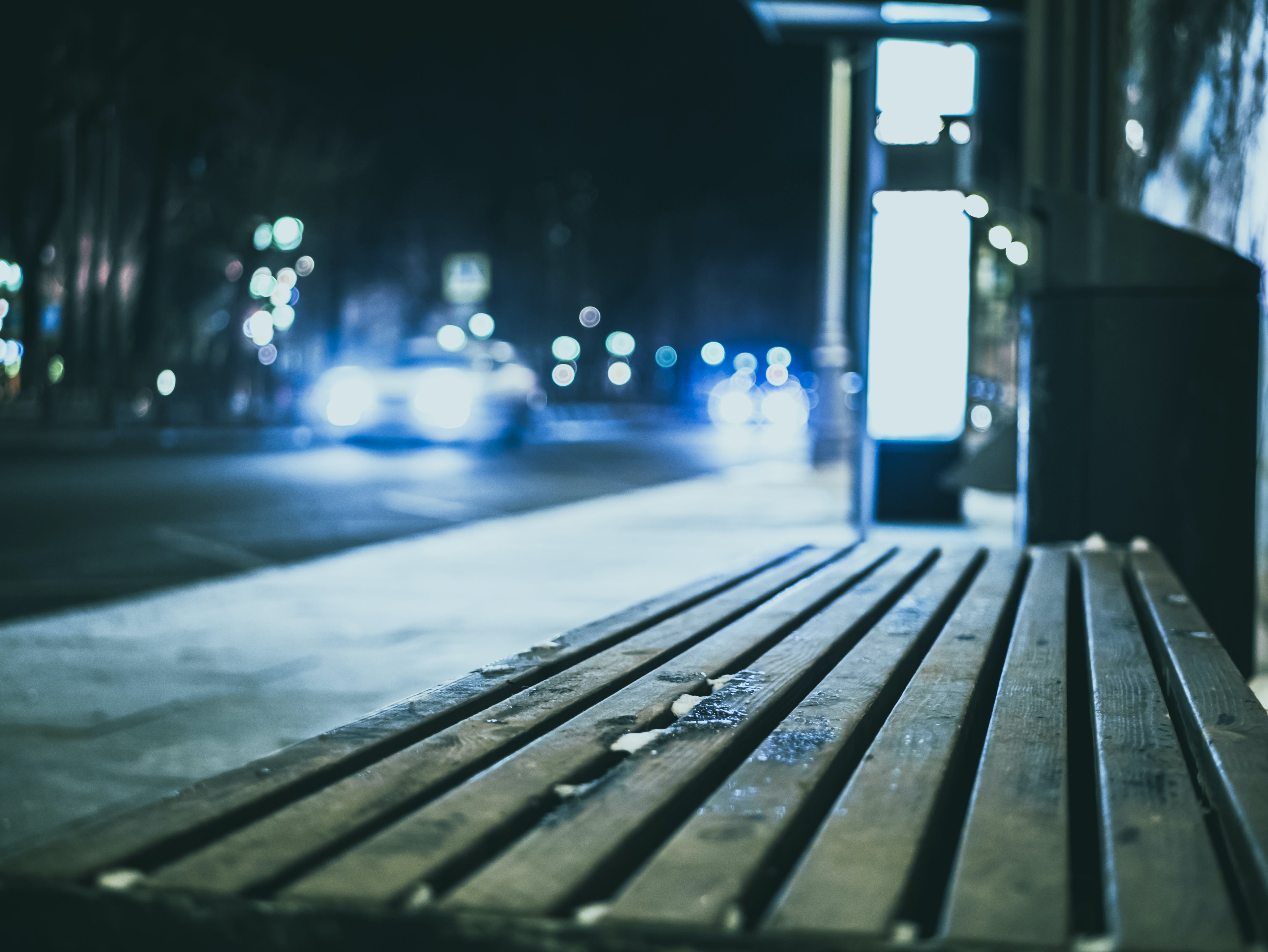 Selective Focus Photography Wooden Bench Beside Road