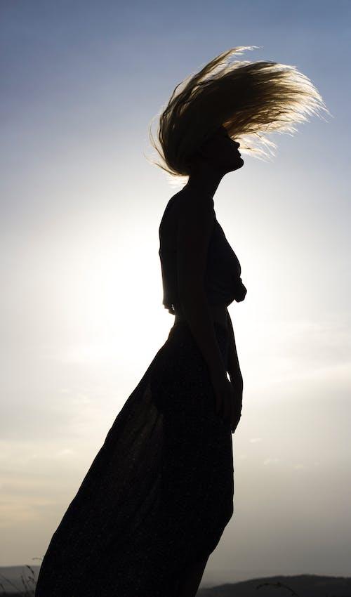 Woman Standing Waving Hair