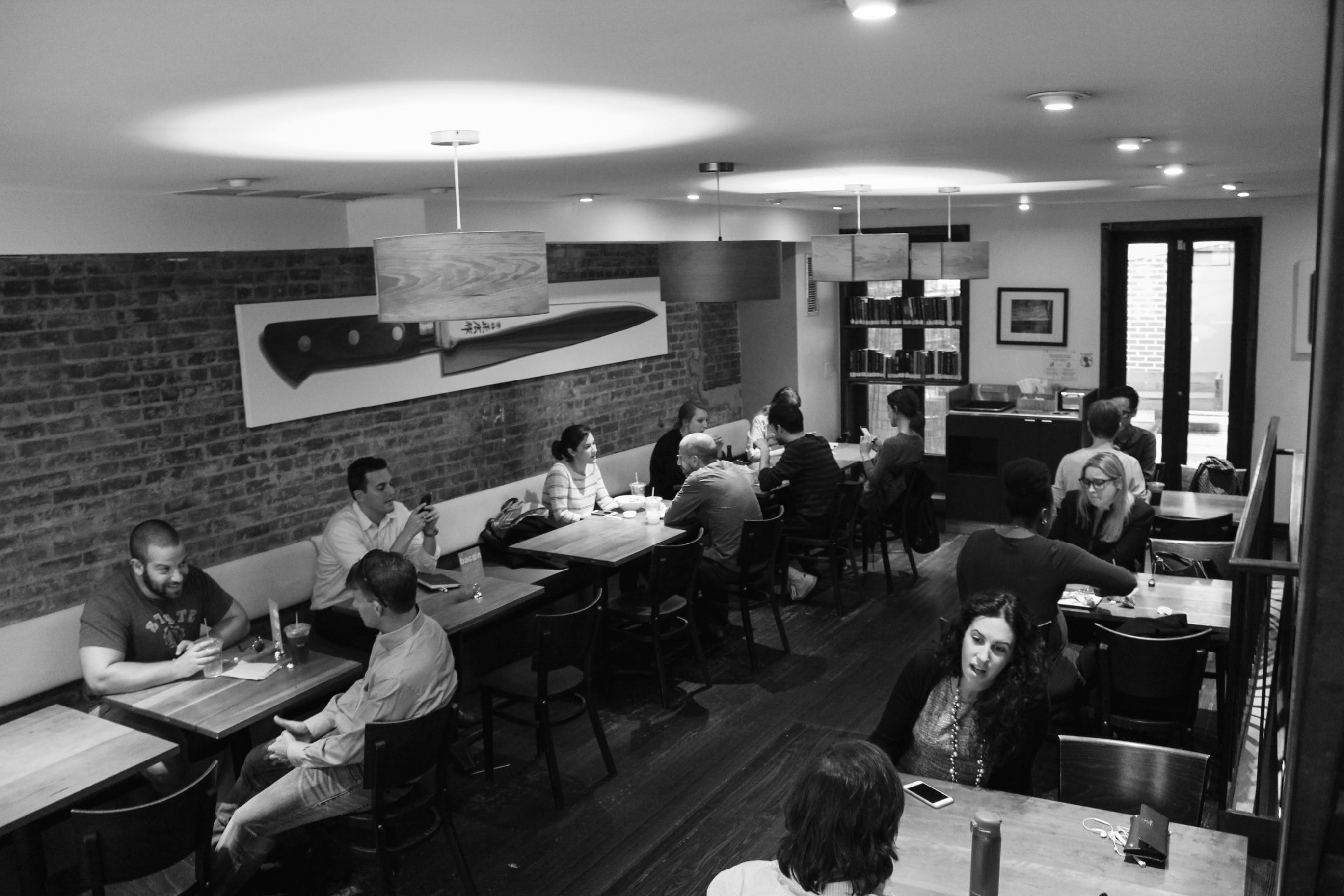 Grayscale Photography of People Inside Restaurant