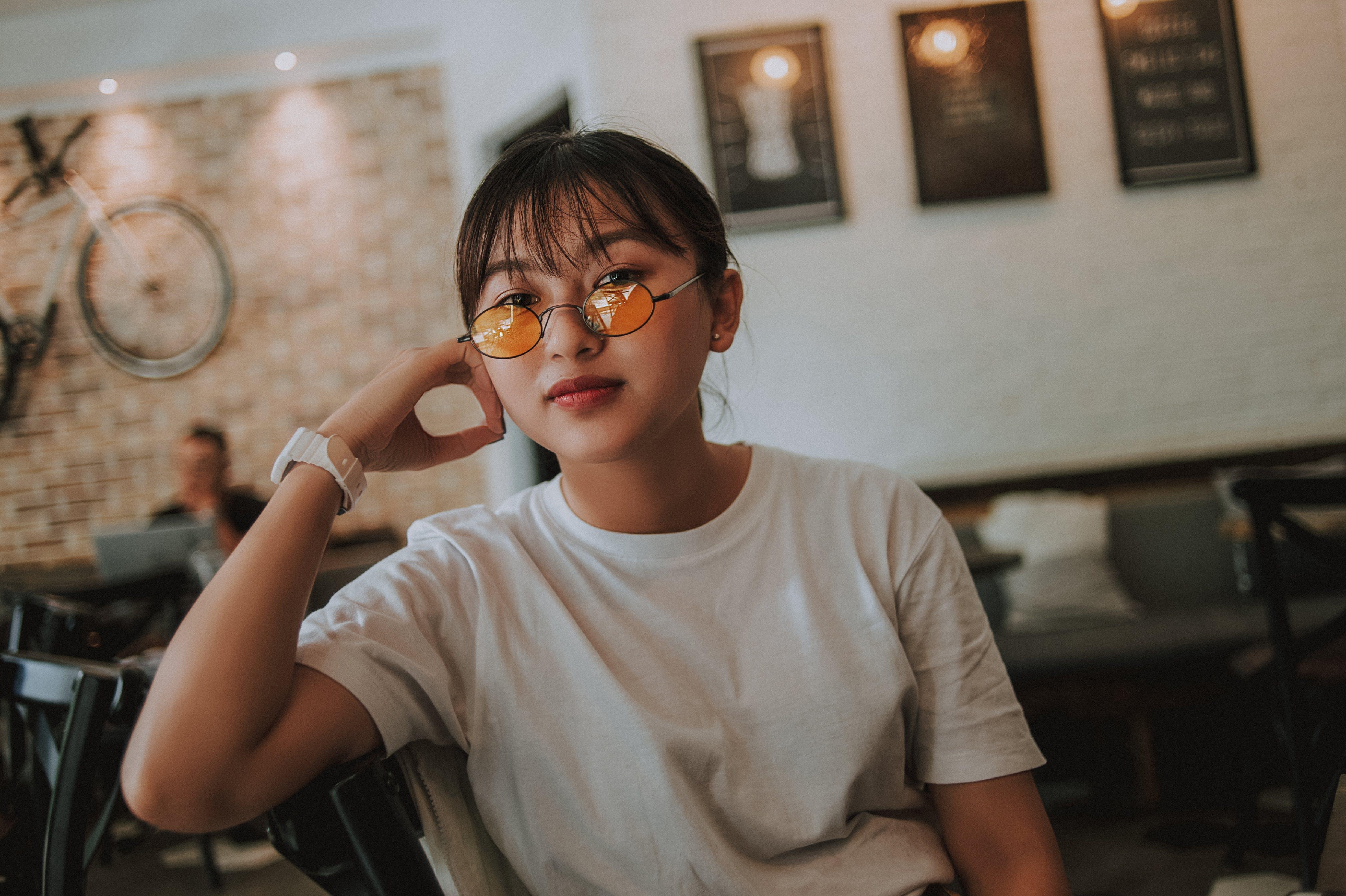 Woman Sitting Wearing Sunglasses