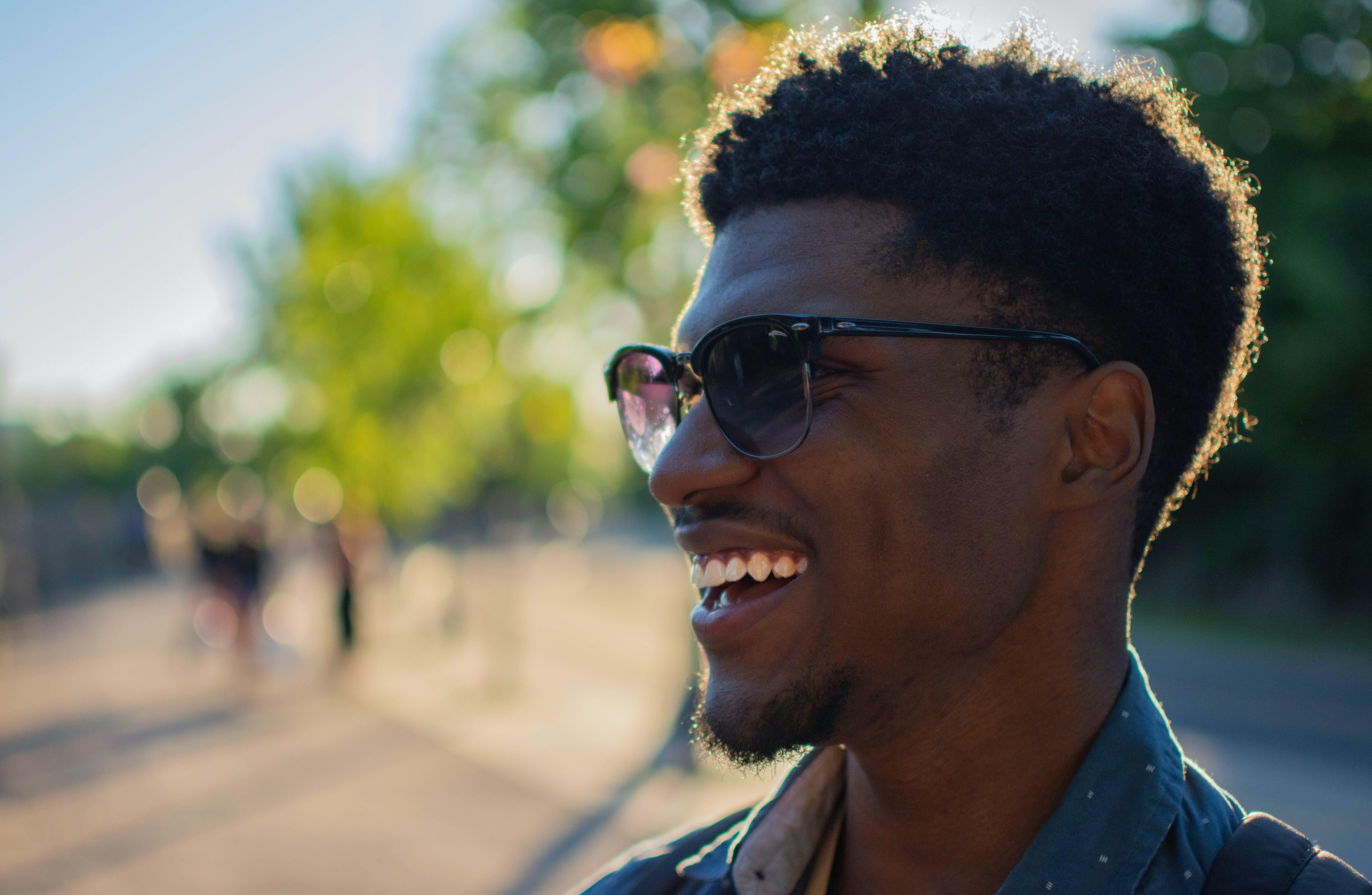 Man Wearing Blue Shirt Smiling Outside