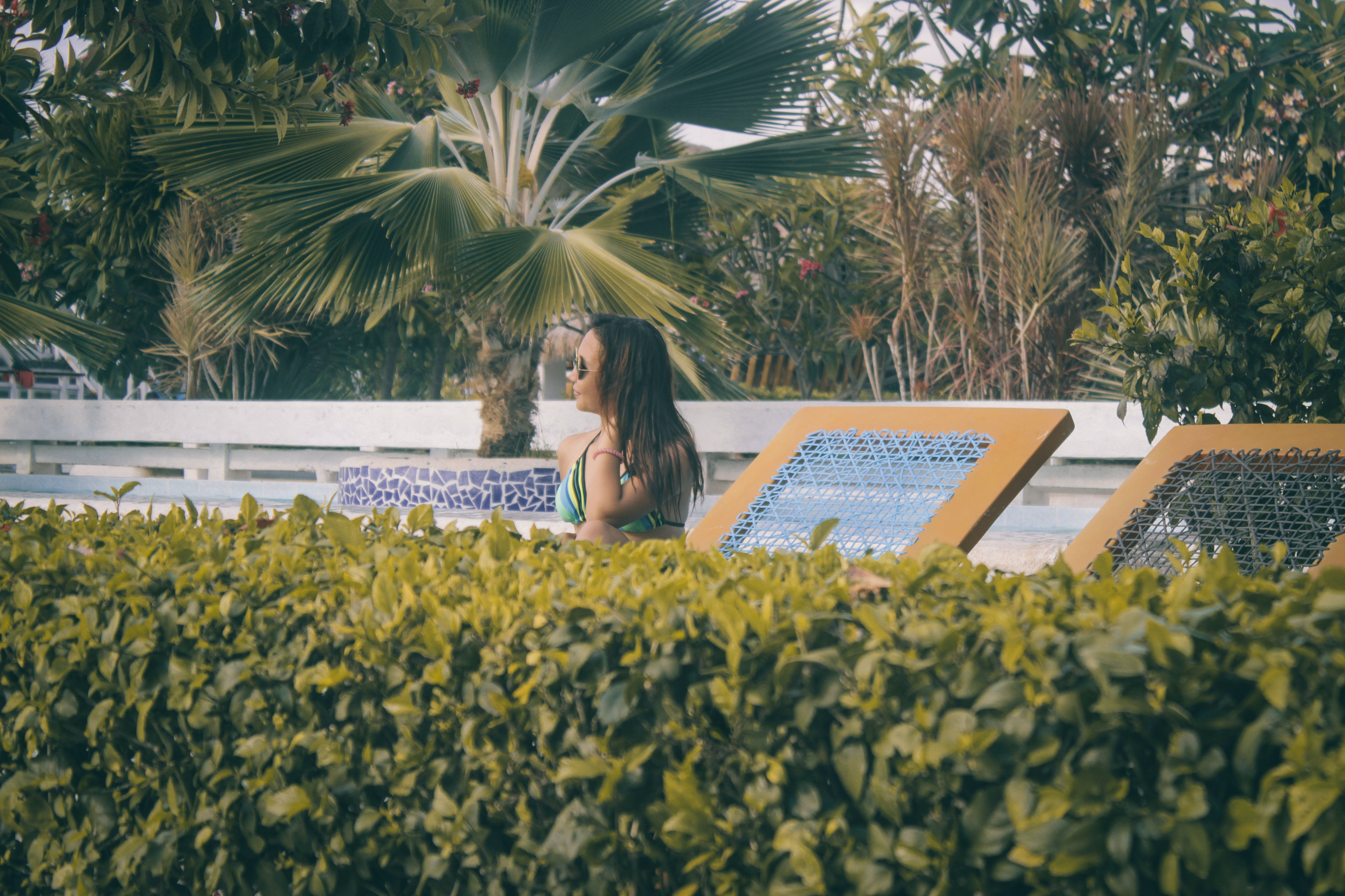 Woman Wearing Teal Bikini Top