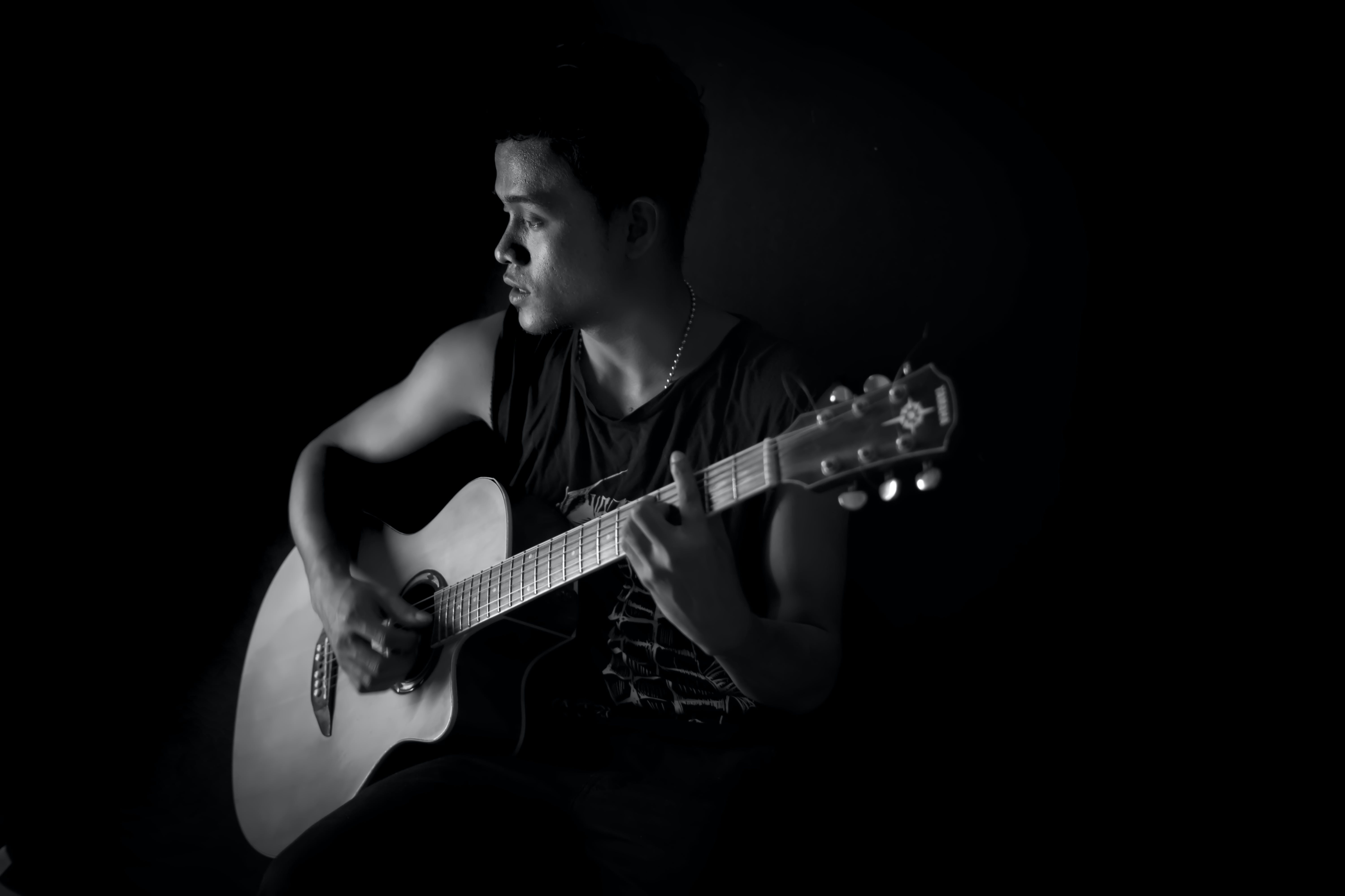 Monochrome Photography of Man Playing Guitar
