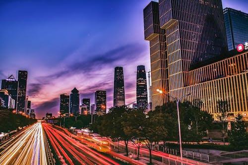 Immagine gratuita di alba, architettura, autostrada, centro città