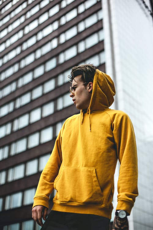 Photography of Guy Wearing Yellow Hoodie