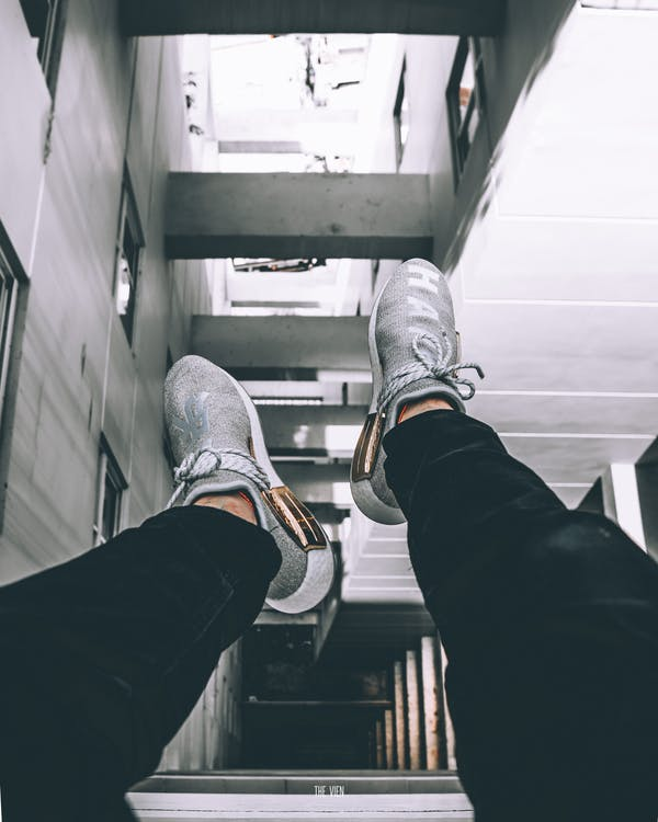 Pair of Gray-and-white Athletic Shoes