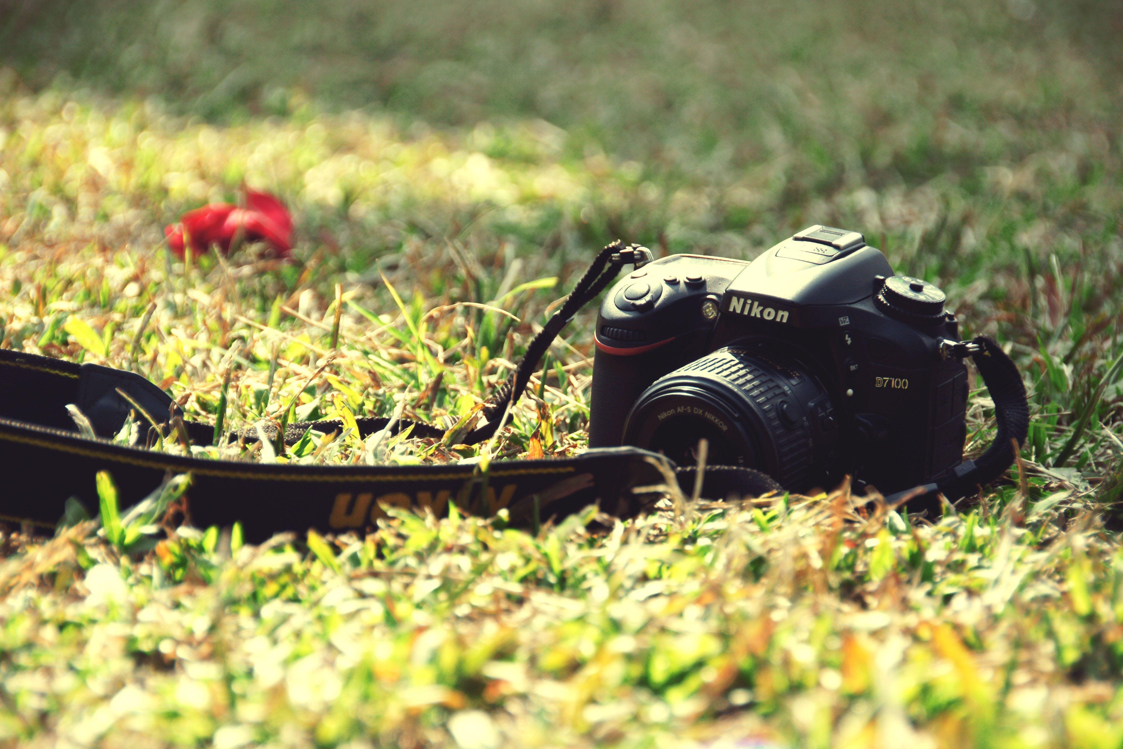 Black Nikon Dslr Camera on Ground