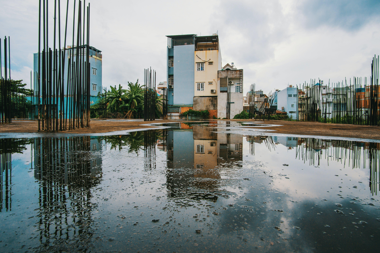 Body of Water Near Concrete Buildings