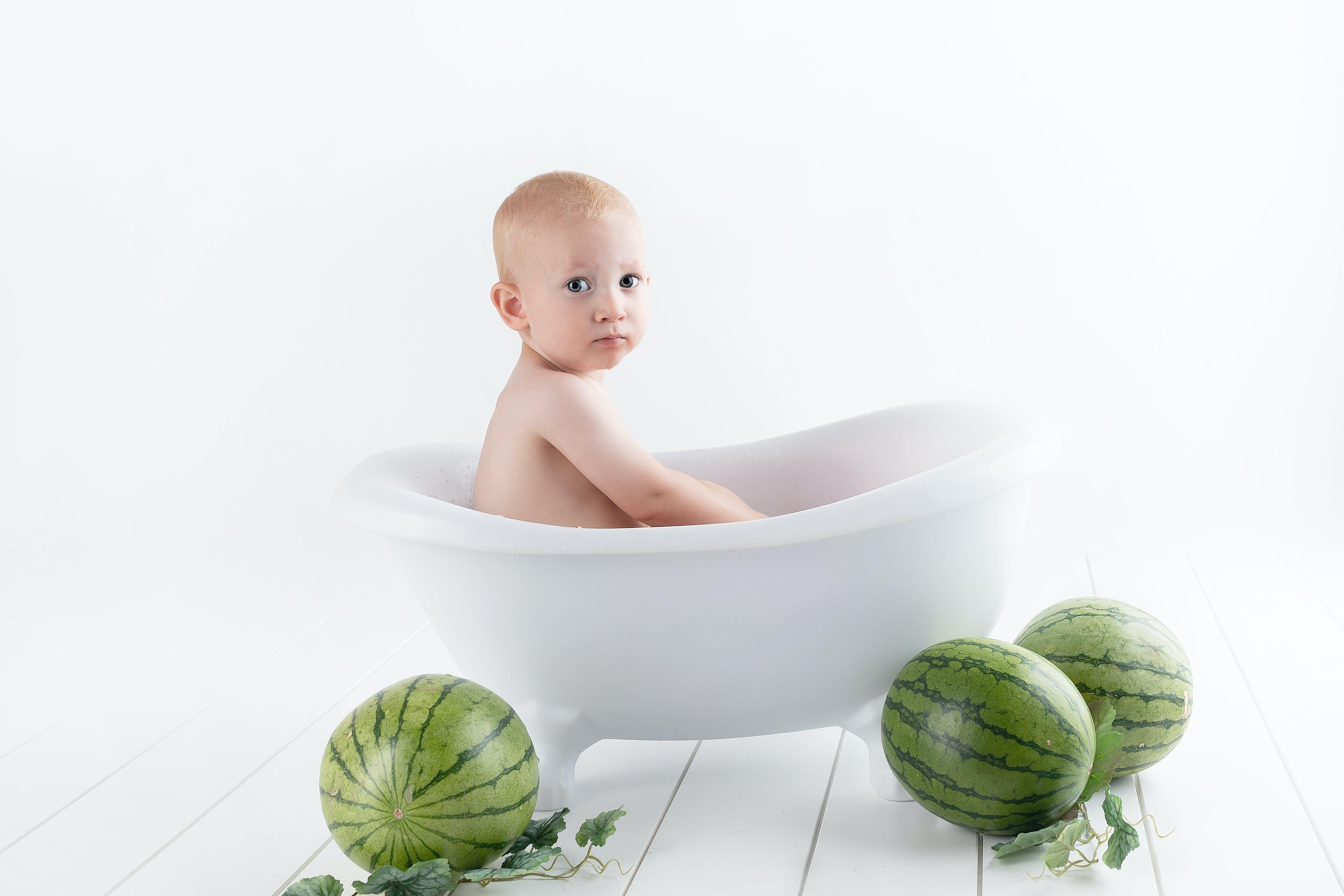 Photography of Baby On Bathtub