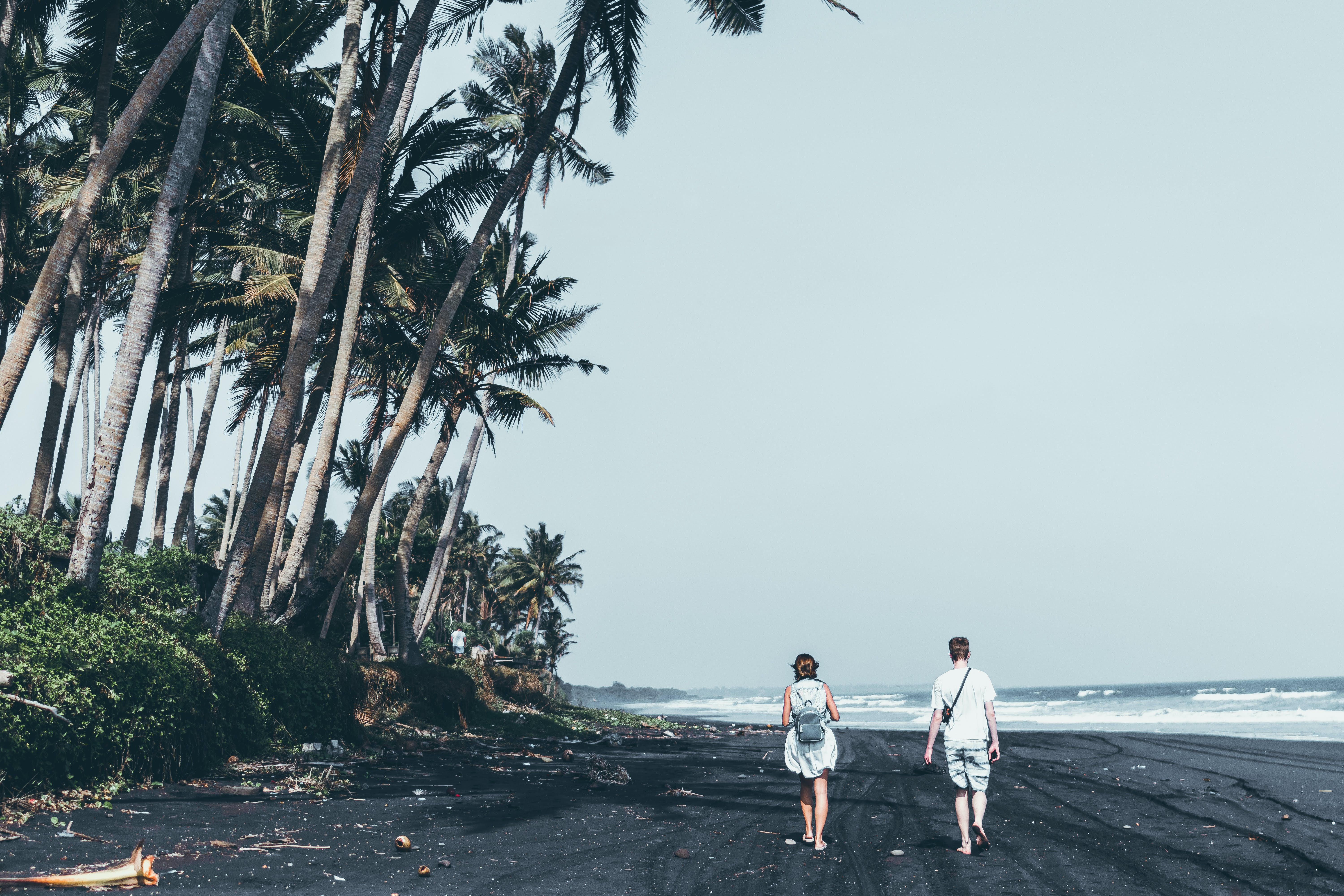 Two People Walking By The Seashore