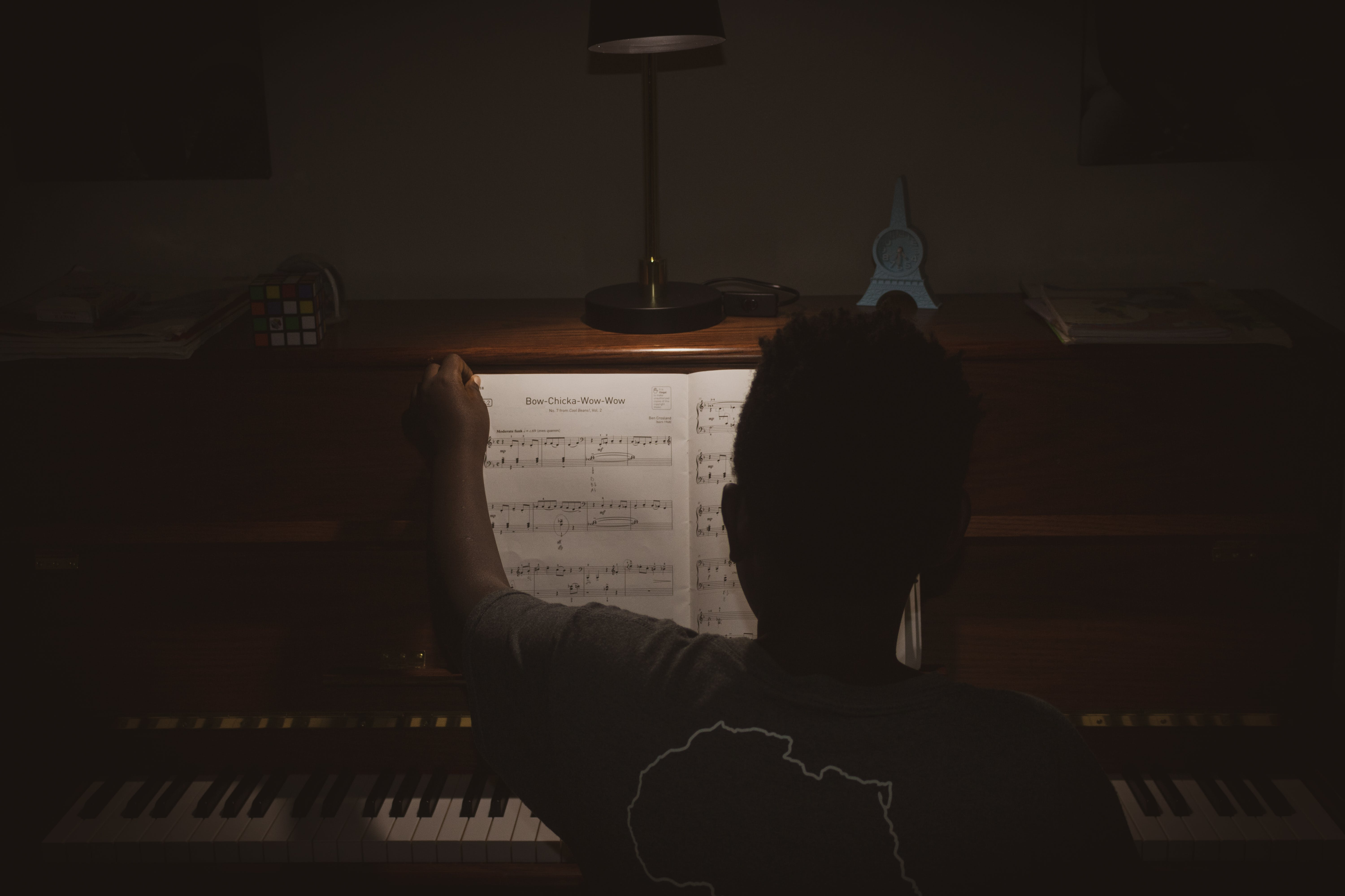 Photo of Person Sitting In Front Of Piano