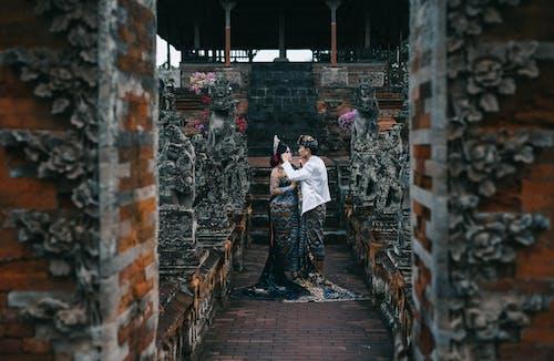 Základová fotografie zdarma na téma architektura, asiaté, asijský pár, chrám