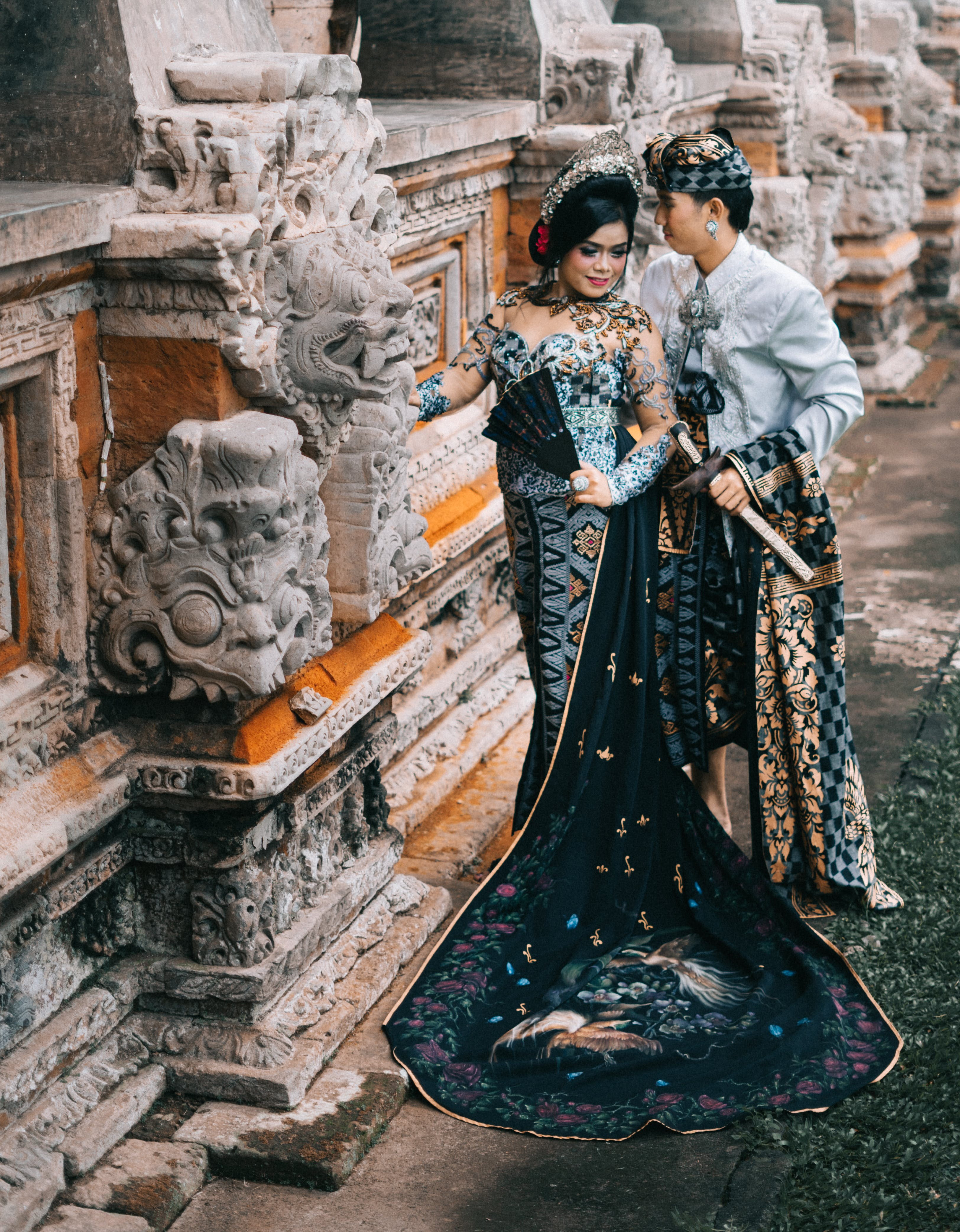Photography of Woman in Black and Blue Lace Dress Beside Man