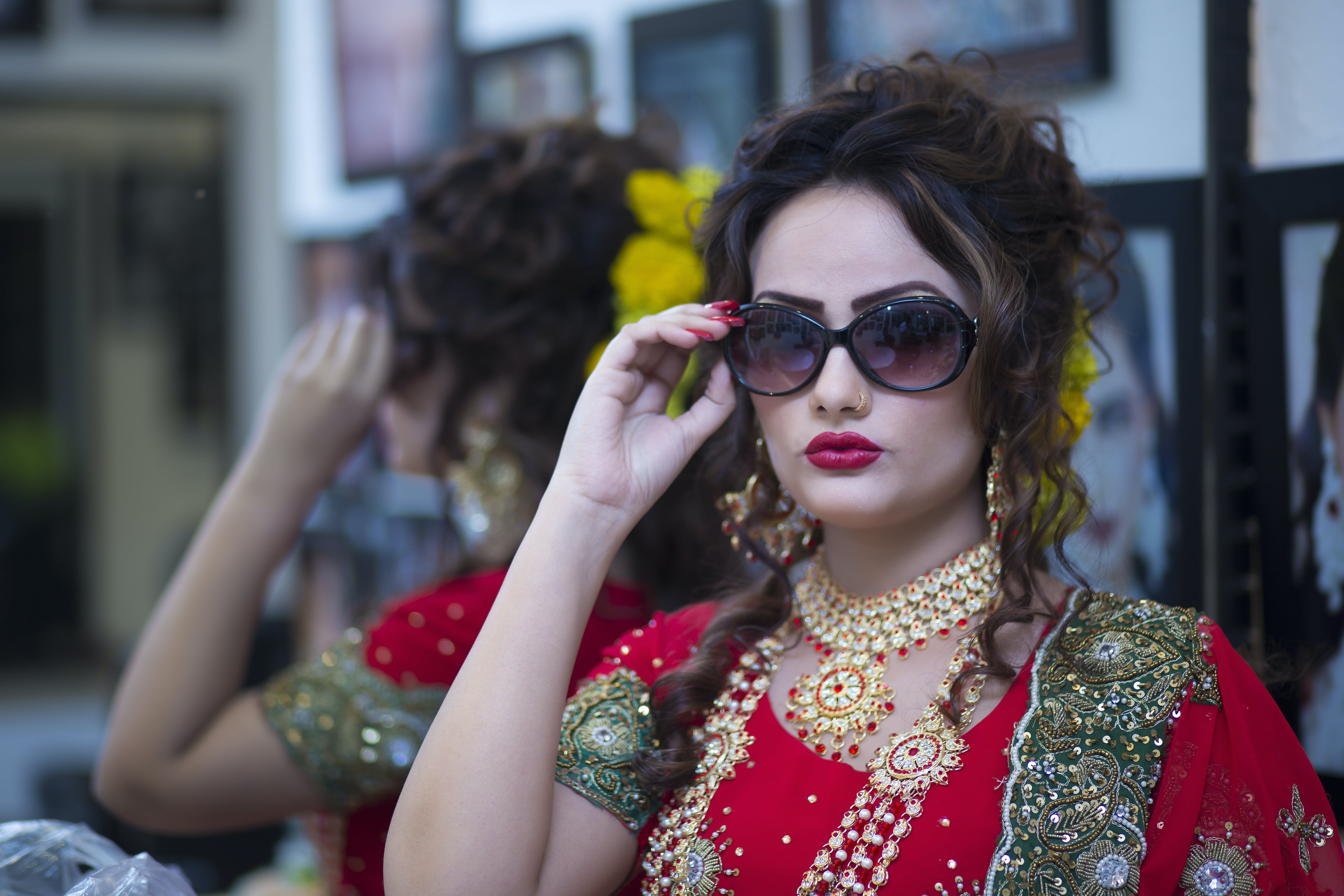 Woman Wearing Red Dress Holding Her Black Framed Sunglasses