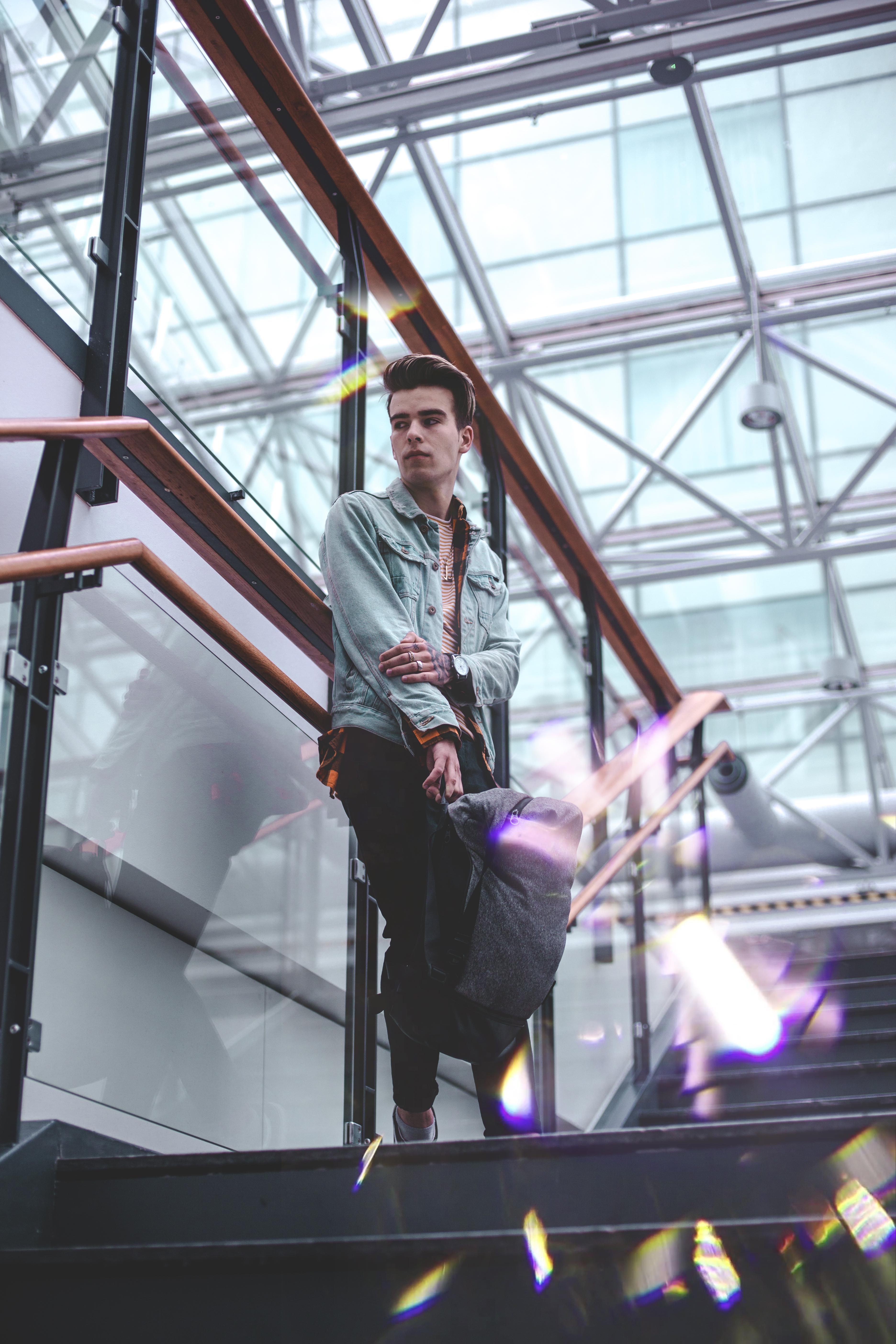 Man in Blue Jacket Standing on Stairs