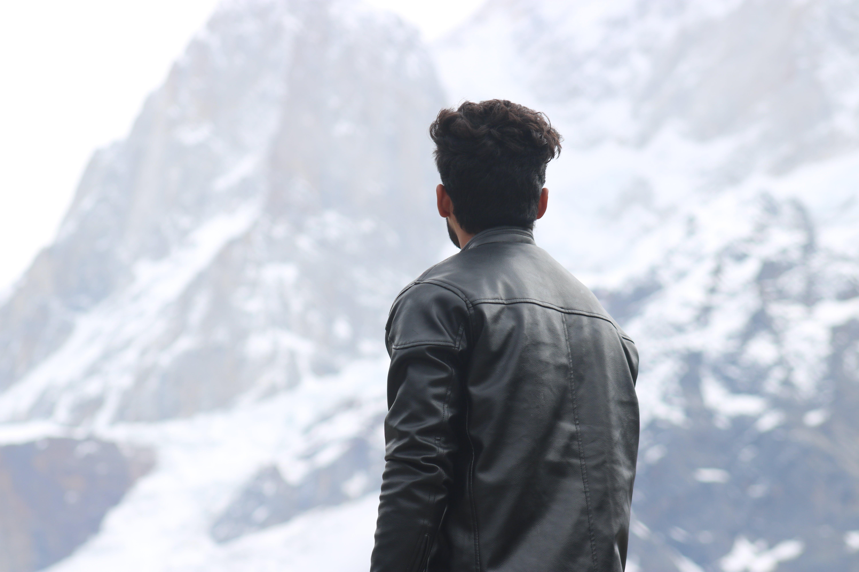 Man Wearing Black Jacket Looking at a Mountain