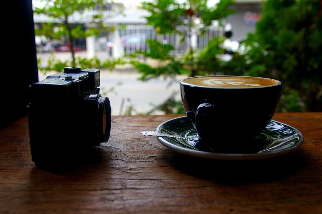 Cappuccino Near on Black Camera