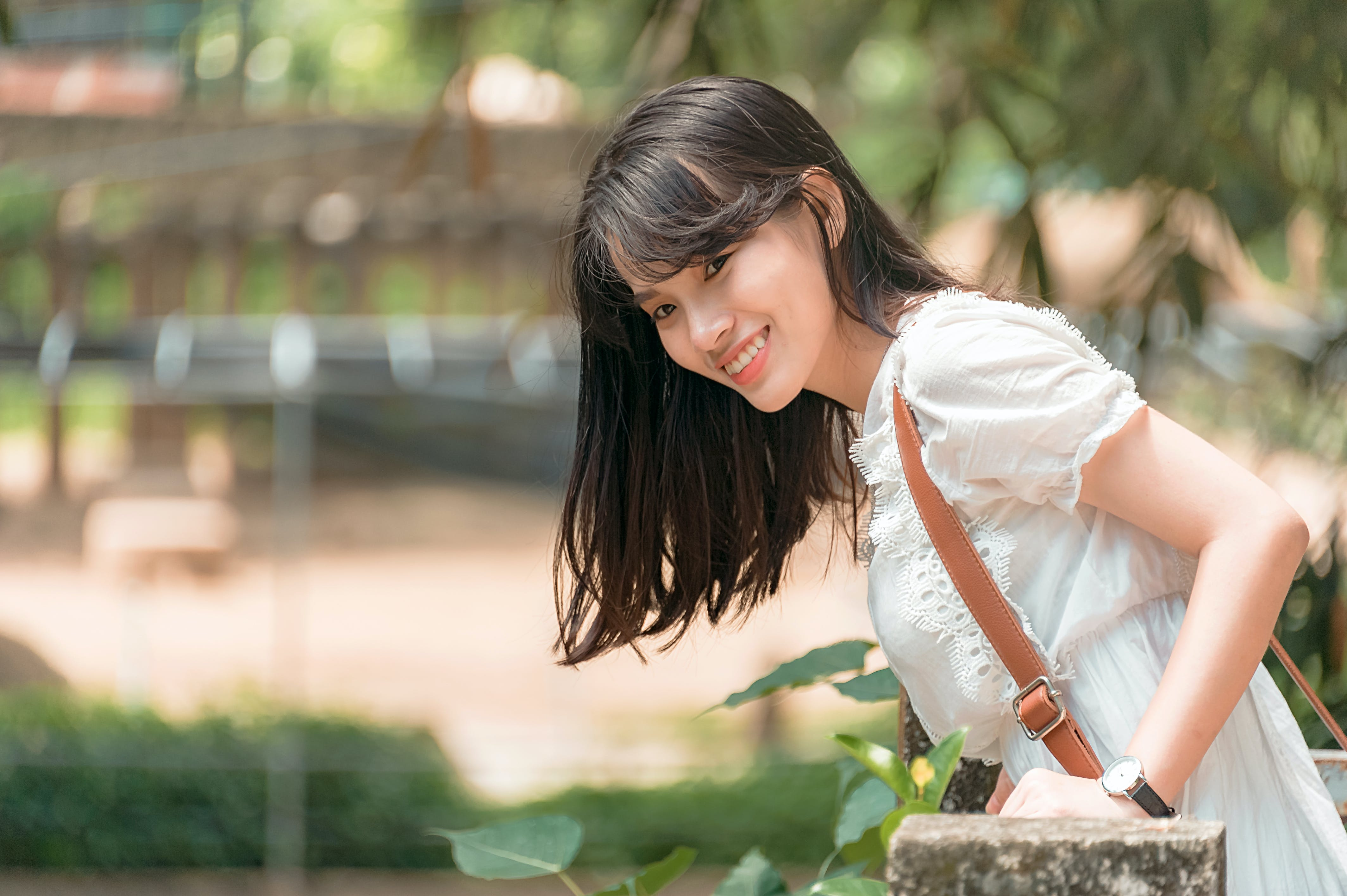 Photo of Woman in White Outfit Smiling.