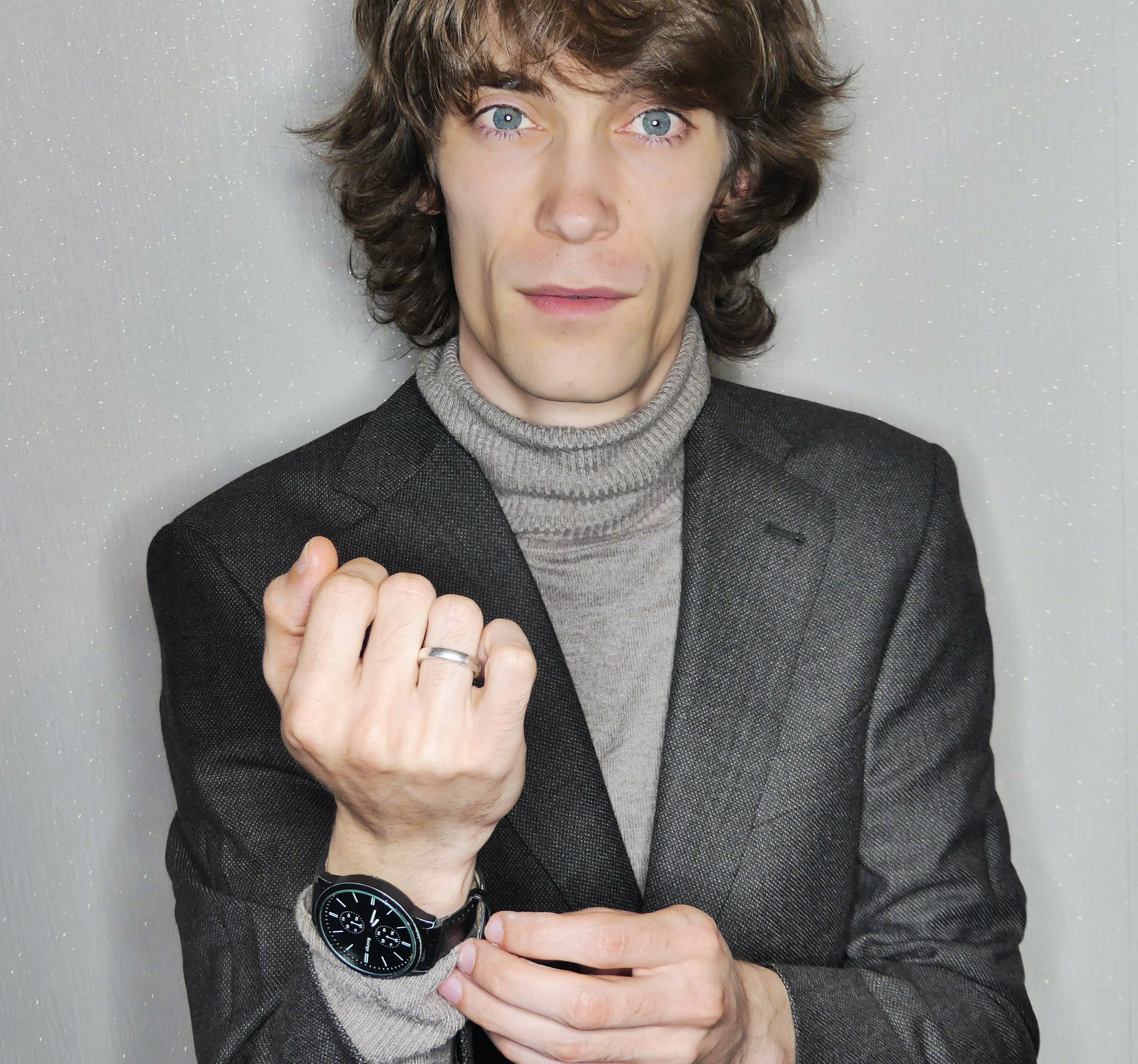Portrait of Man Wearing Gray Suit Jacket.