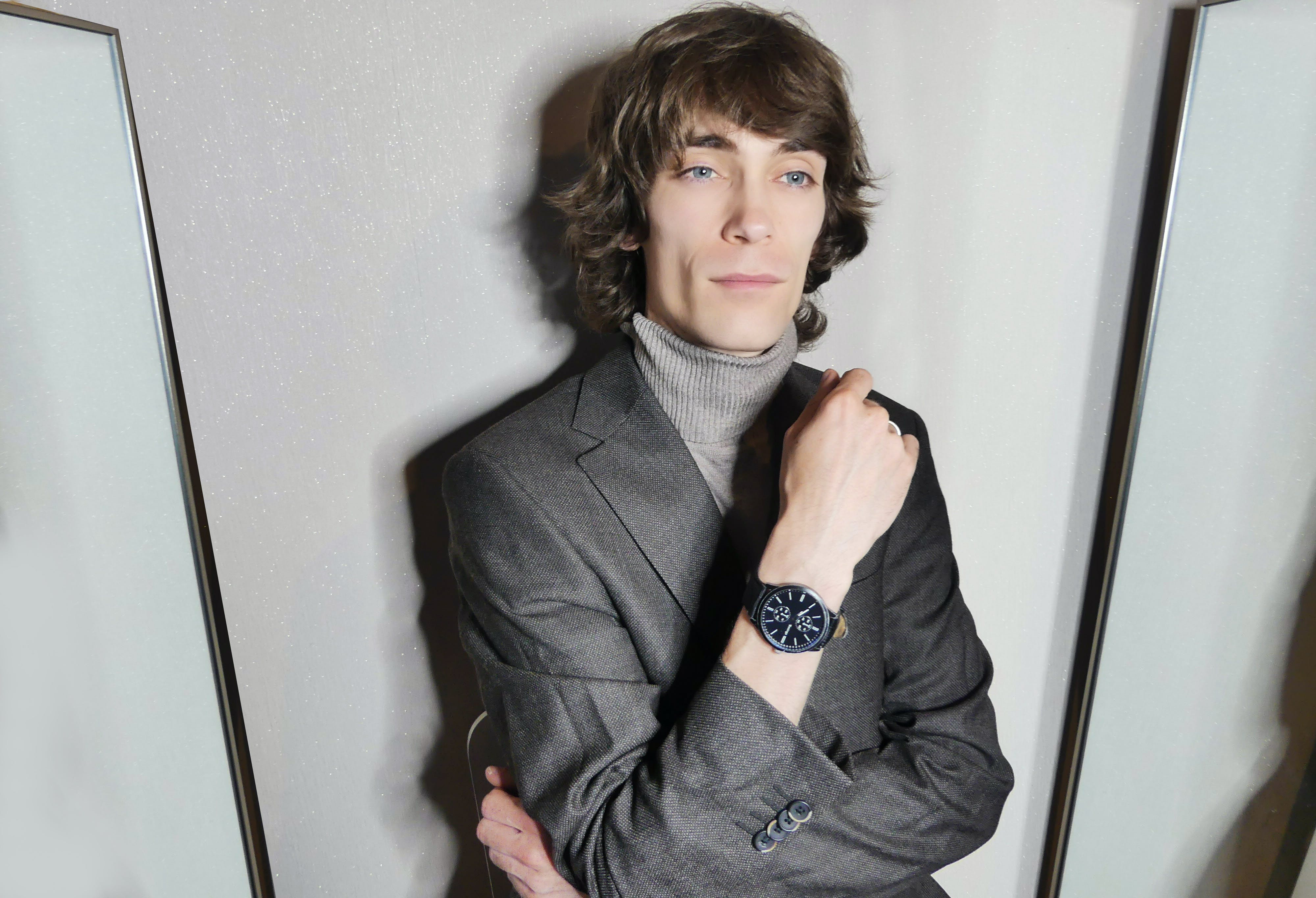 Portrait of Man Wearing Gray Suit Jacket Posing.