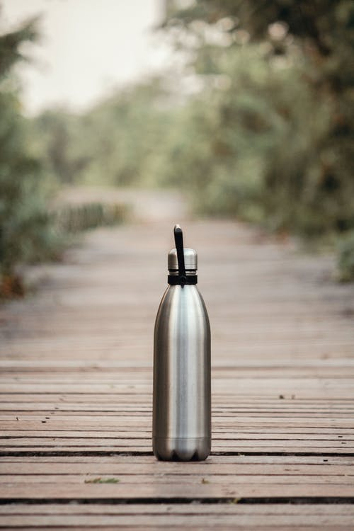 Vacuum Flask On Brown Wooden Dock