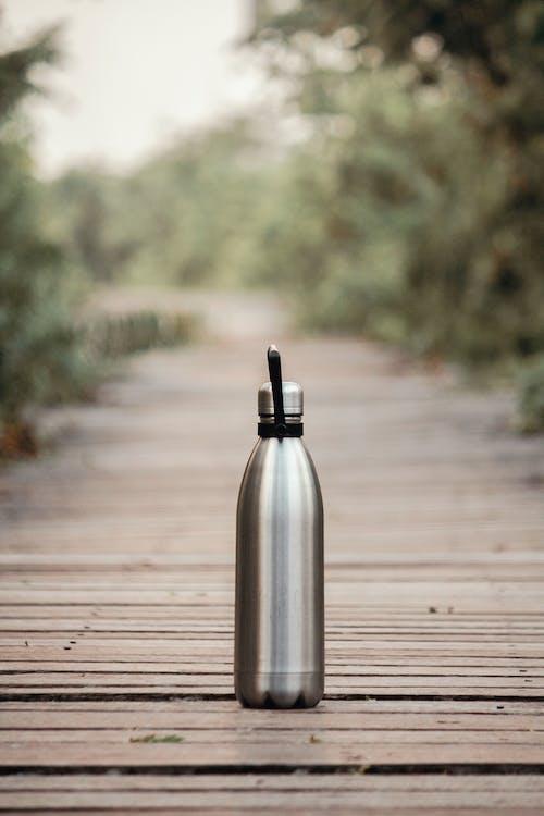 Vacuum Flask On Brown Wooden Dock