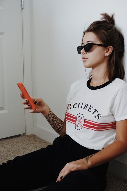 Woman Wearing Black Sunglasses Holding Android Smartphone